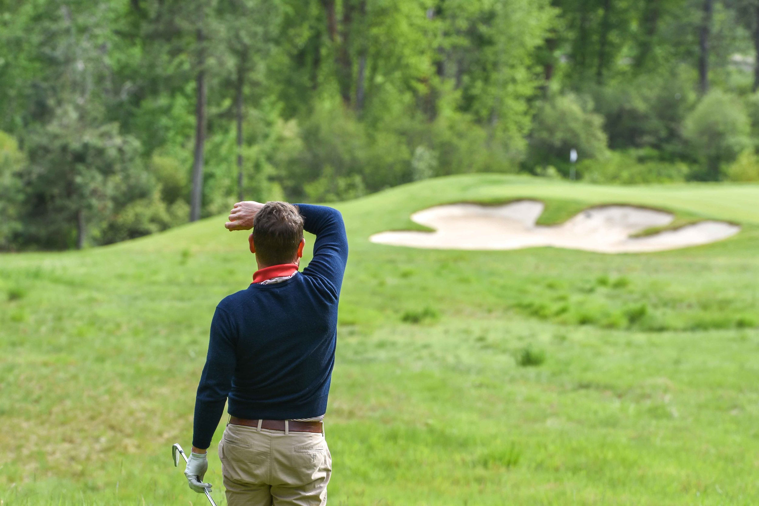 The Director of Golf at Circling Raven,  Dave Christenson , watches his golf ball land safely on the 16th green.