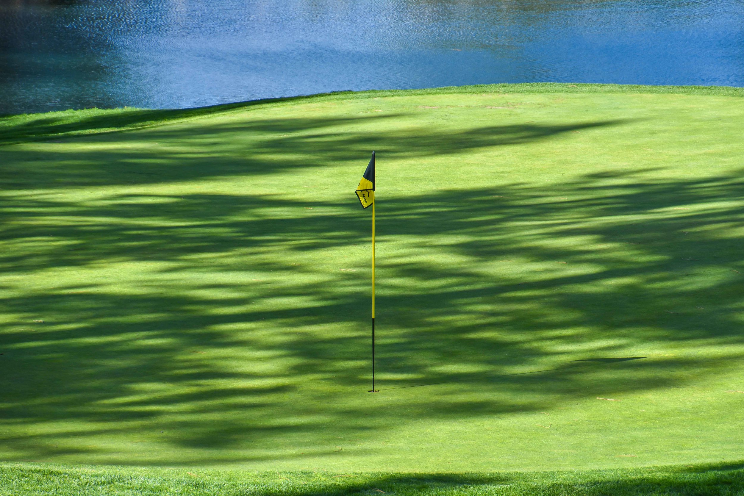 Shadows fall on the 16th green at Coyote Moon.
