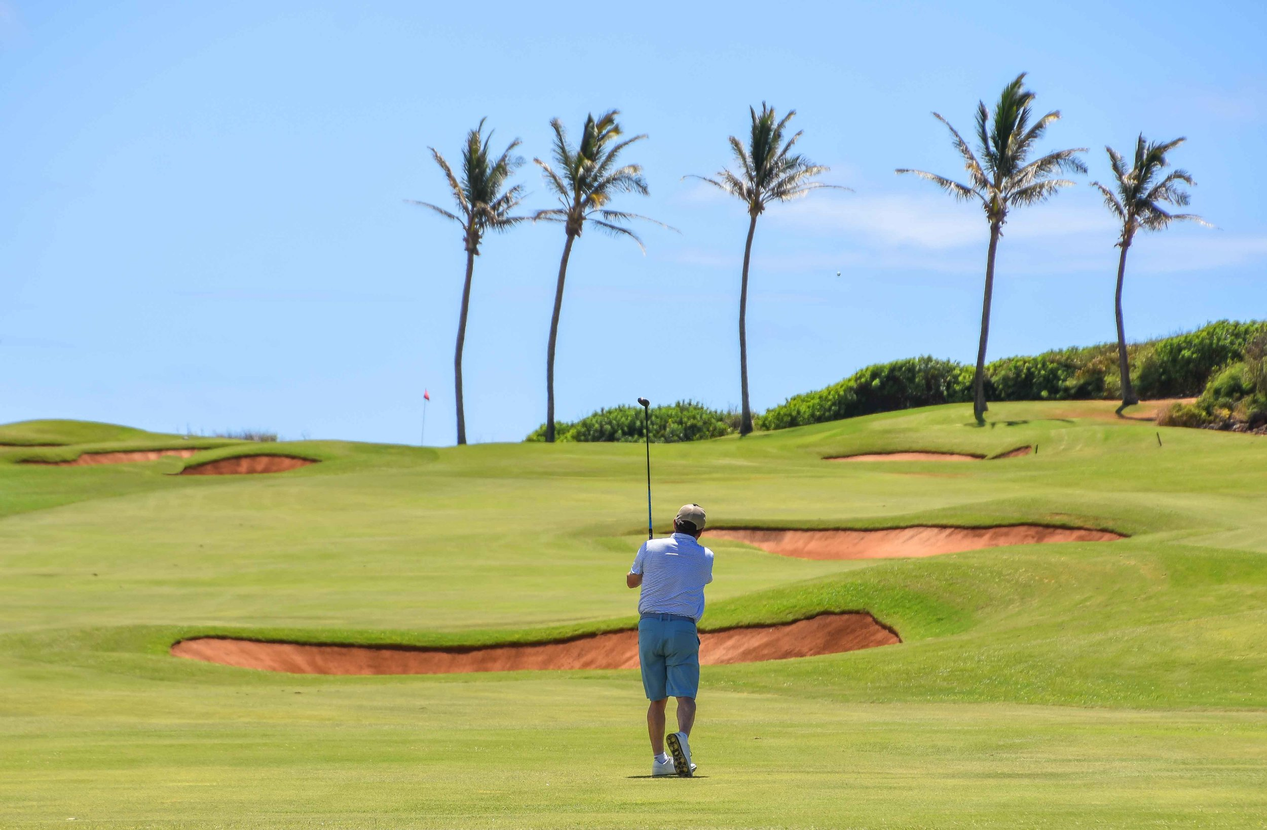 Mike Bailey sends one screaming into the 15th hole at Poipu Bay.