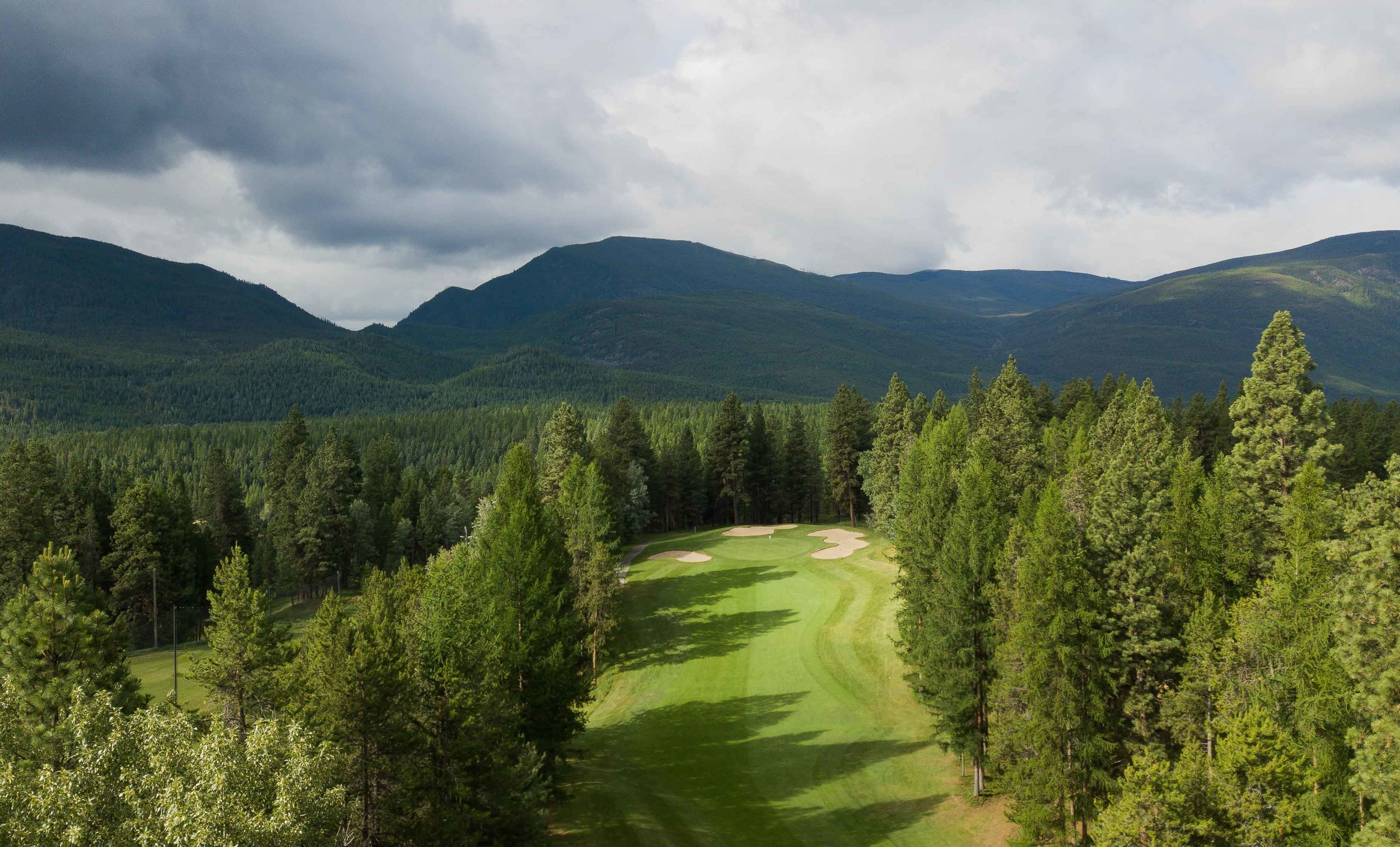 Just golf, trees, and mountains at Kimberley Golf Club.