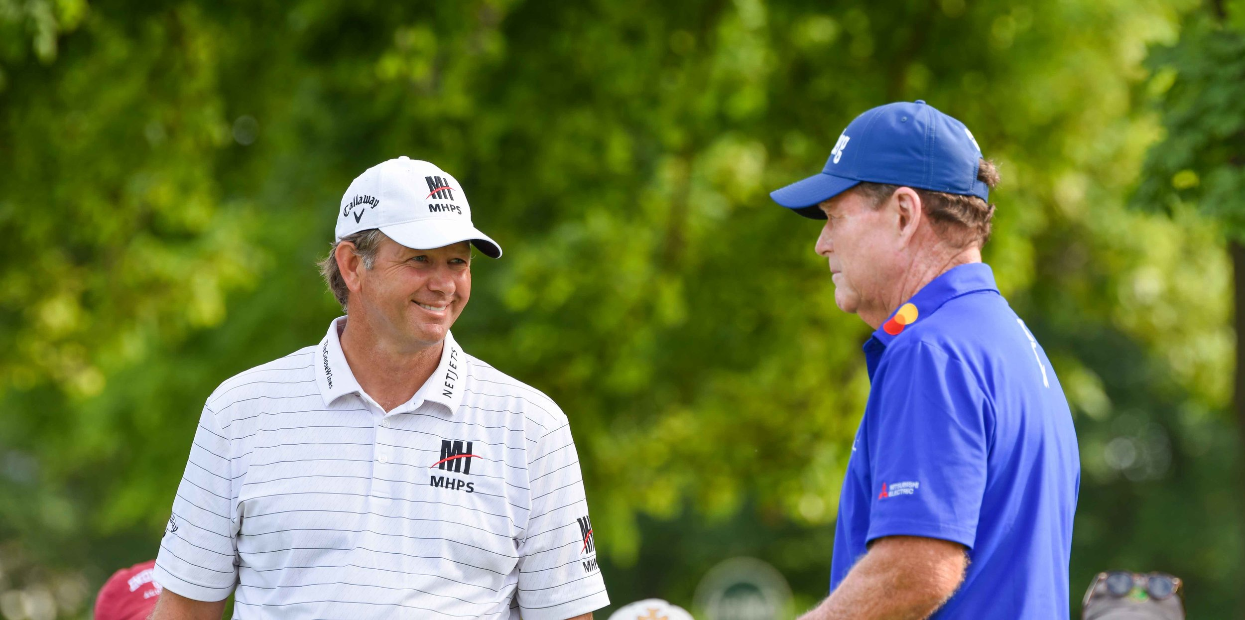 Retief Goosen and Tom Watson chat it up.