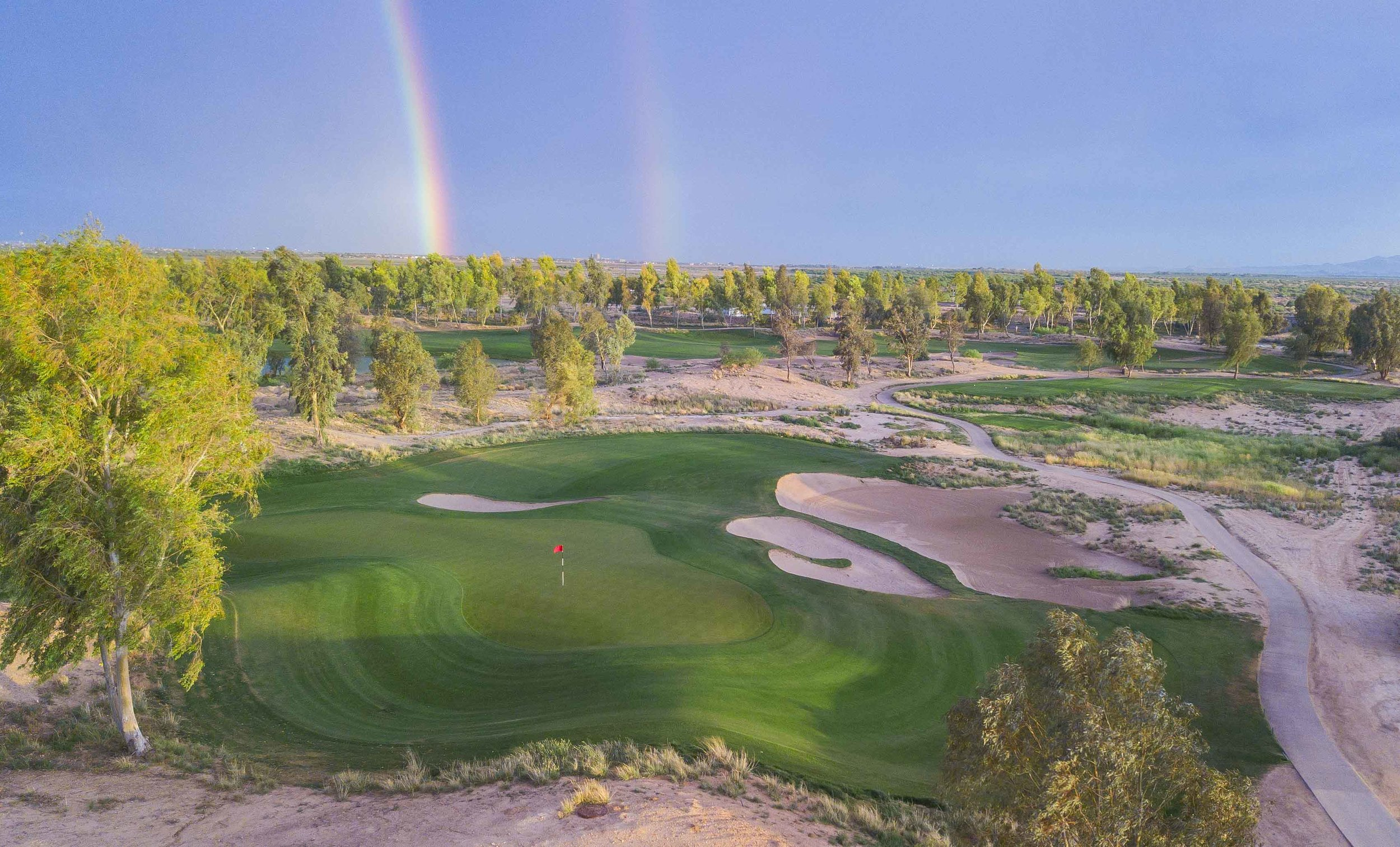 A double rainbow over the 11th hole at Southern Dunes