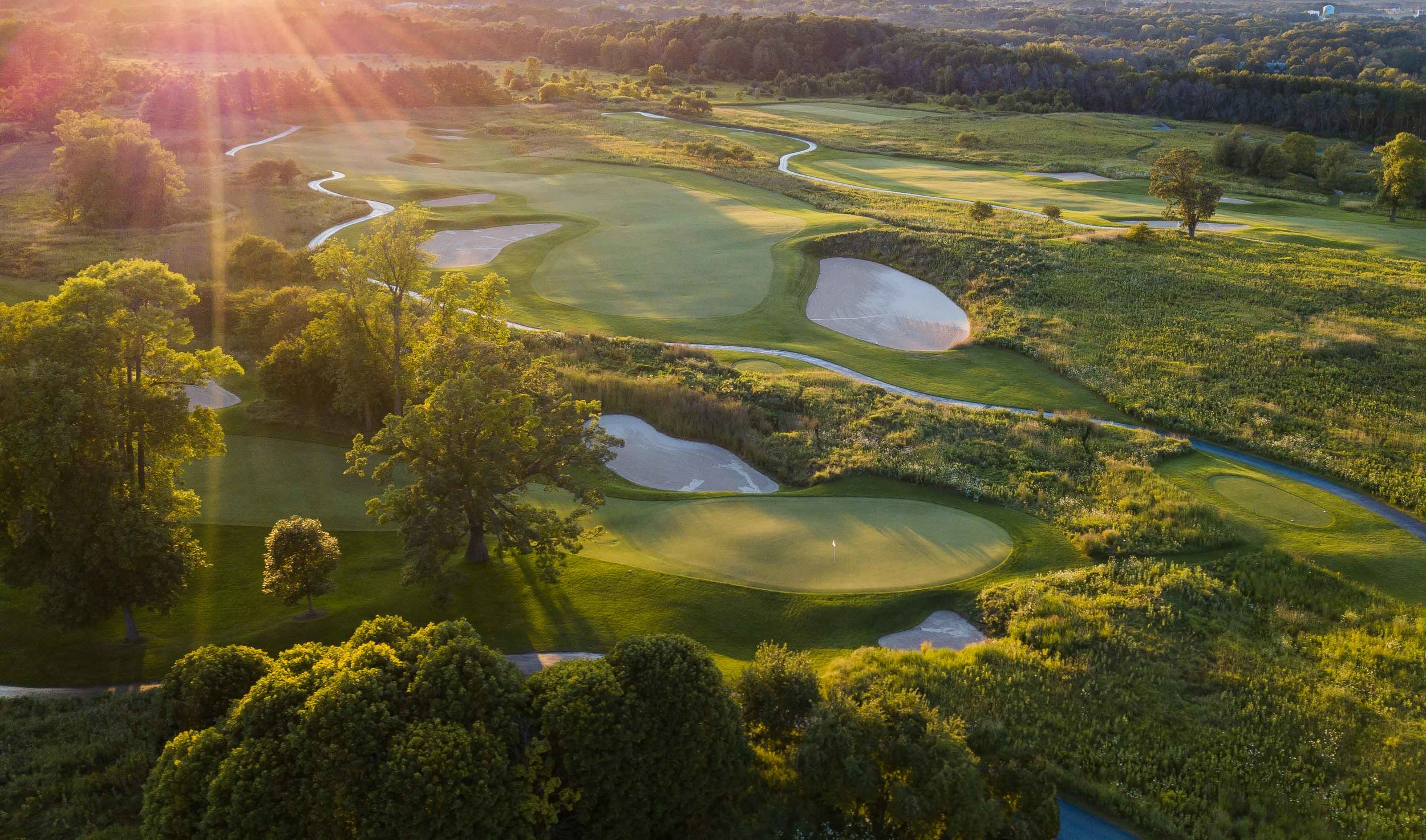 The last of the day's sun splashes down on the Meadow Valleys Course at Blackwolf Run.