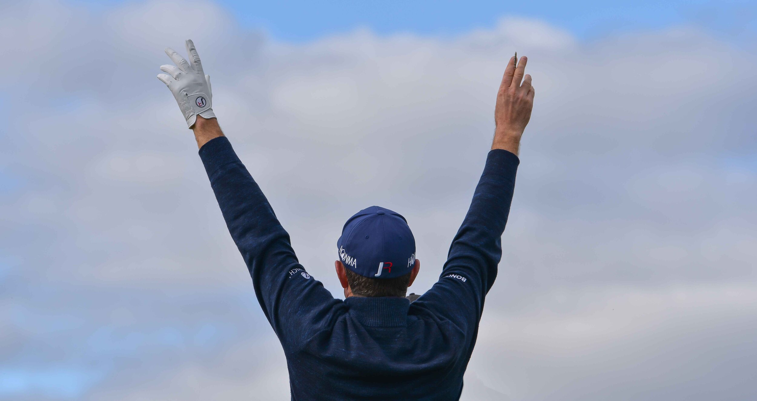 Justin Rose shows his excitement after learning the news that Patrick Koenig had joined the Dunhill Links media team.