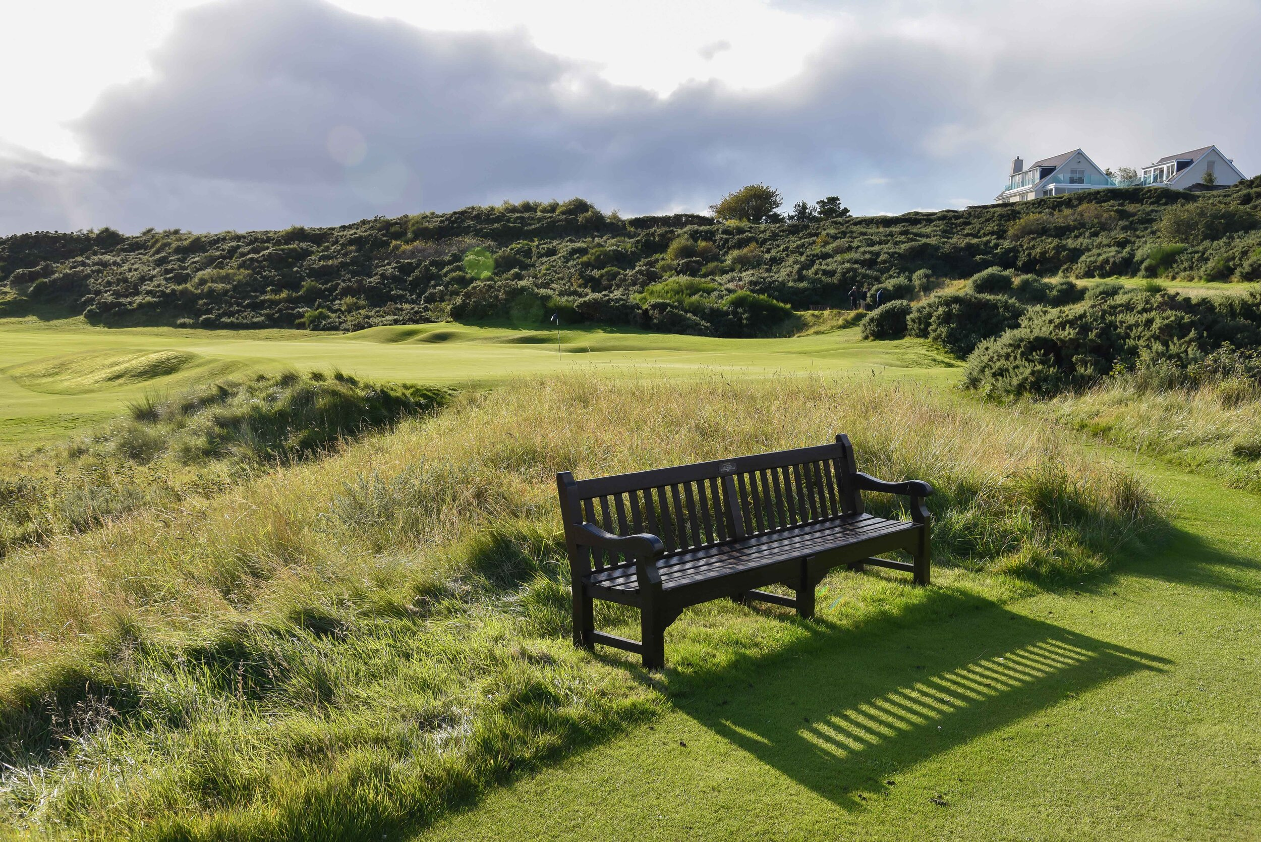 The bench behind #11 looking back onto #4 green.