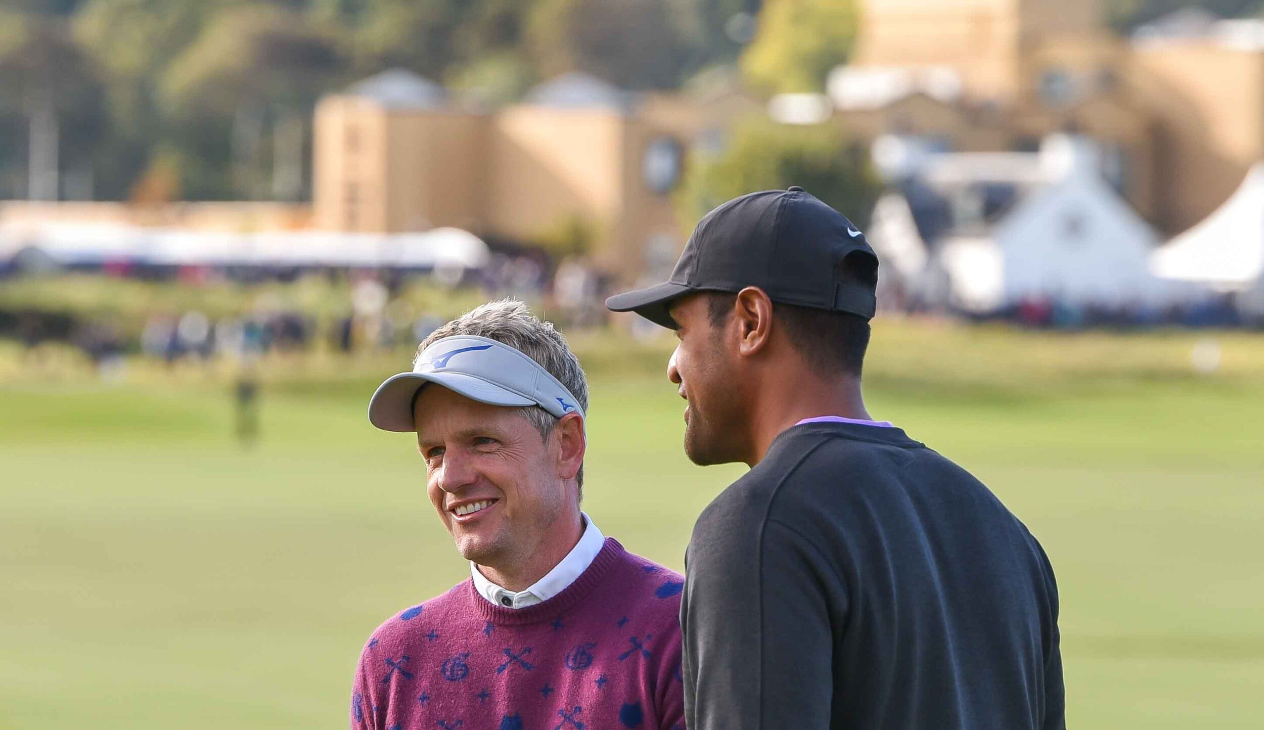 Luke Donald is all smiles after holing out for eagle on 18.