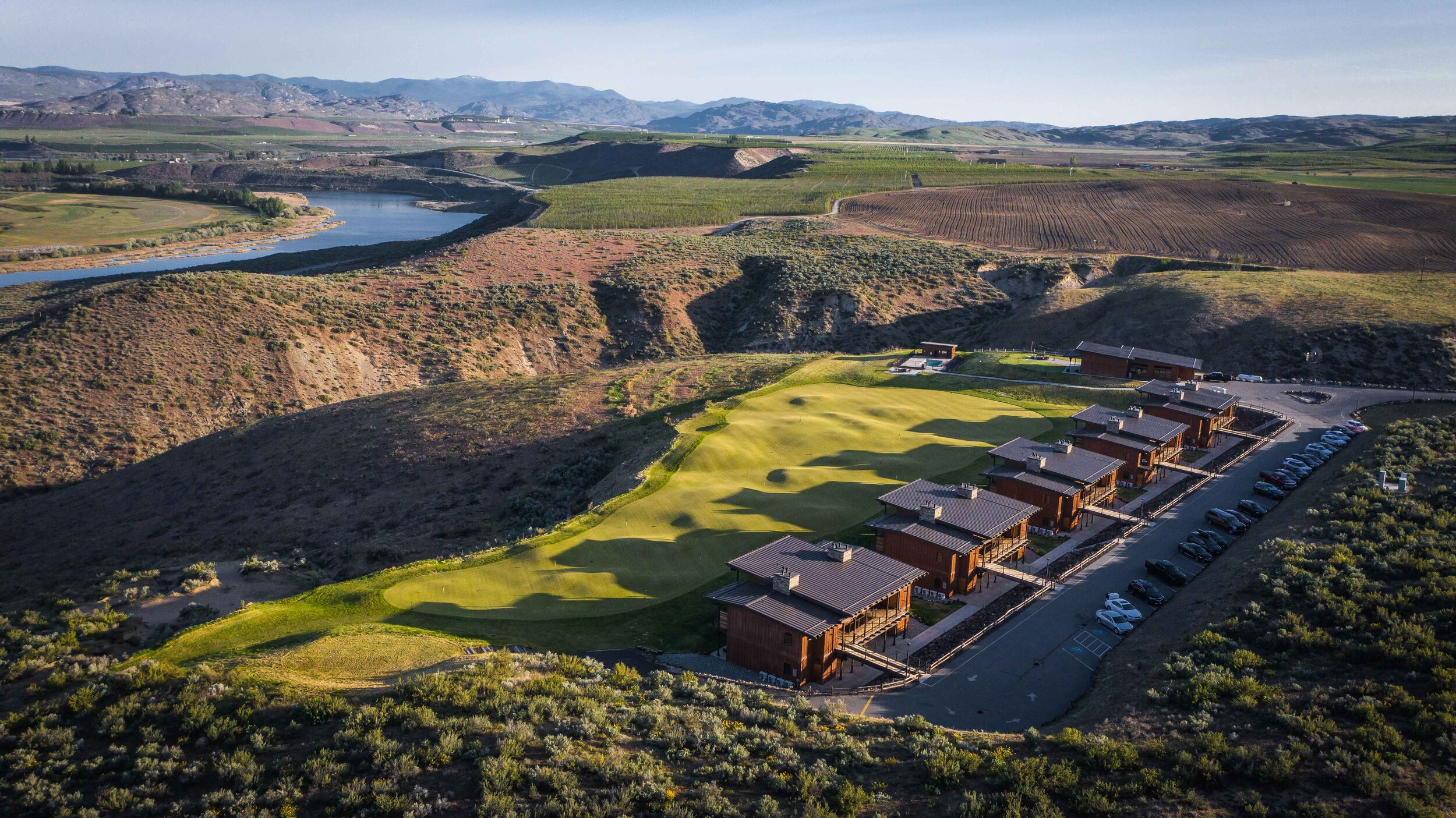 The newly established golf cottages at Gamble Sands overlook the Cascades putting course.