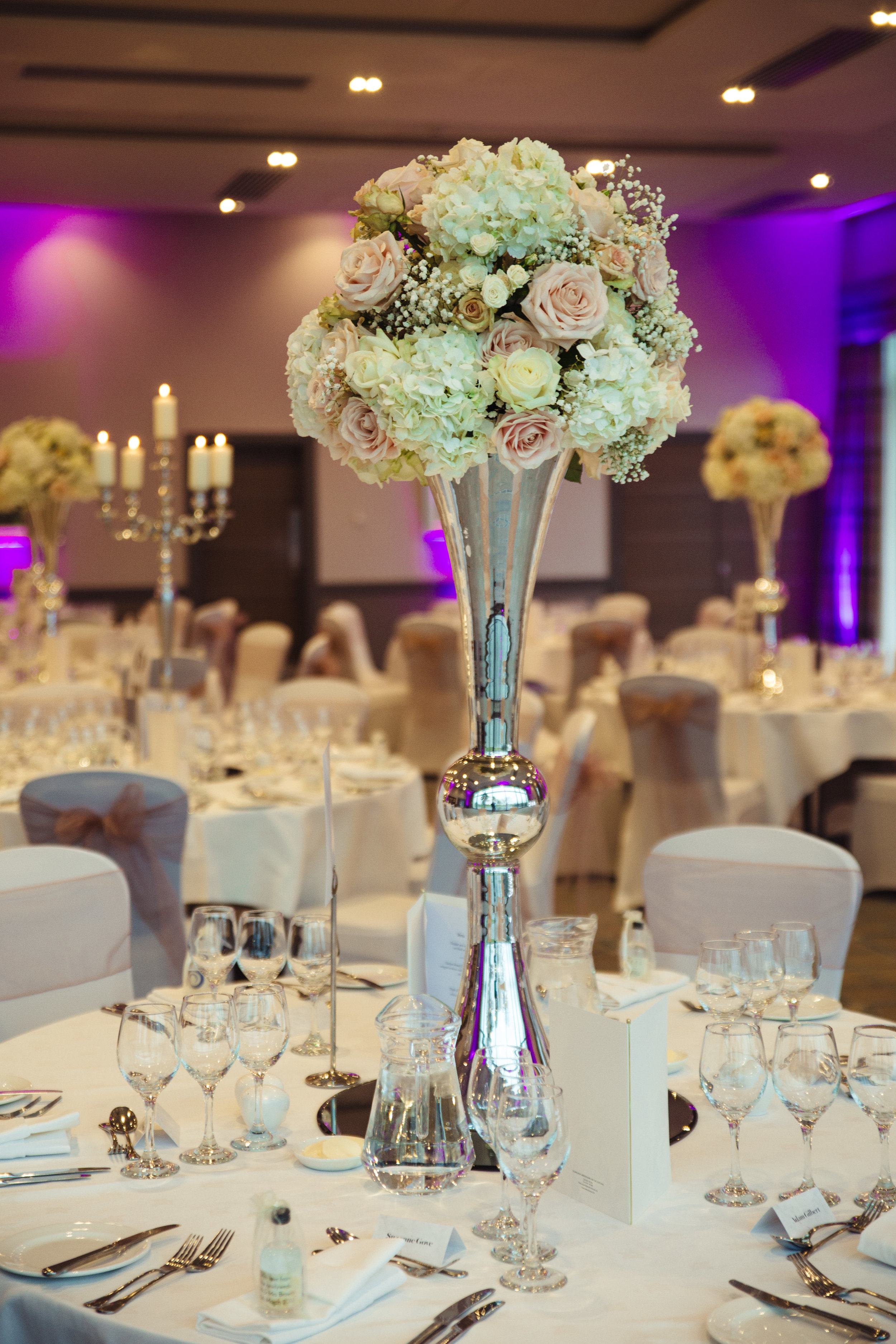 claires style was very classic and elegant and we added a bit of grandeur by using beautiful big silver vases