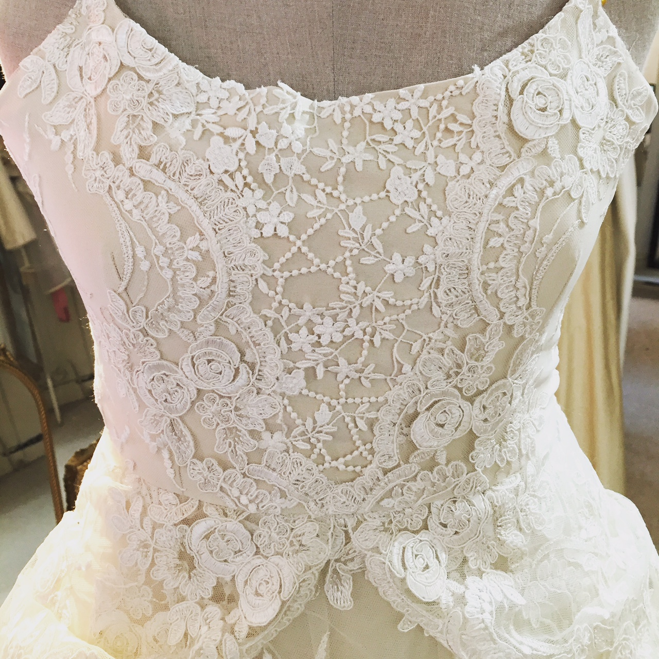 At My little Wedding Shop, we like to use lace in a way that creates a beautiful silhouette or accentuates certain parts of the design. This bohemian inspired creation for our bride Sarah is no exception! By combining the finest sandwash silk with 5 different laces, we ensured that Sarah's gown was not only truly unique, but even more than she had dreamed of! In this close up shot, it really highlights how the lace draws your eye to the smallest point of your figure and back out again over the hips.