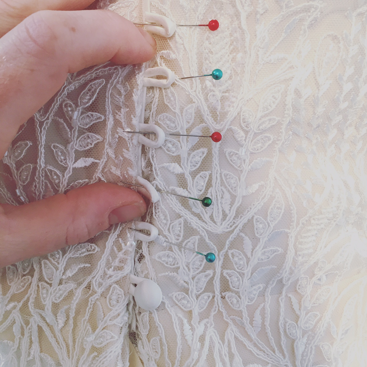We do love our silk covered buttons which are sewn on by hand to ensure they are secure for your wedding day.