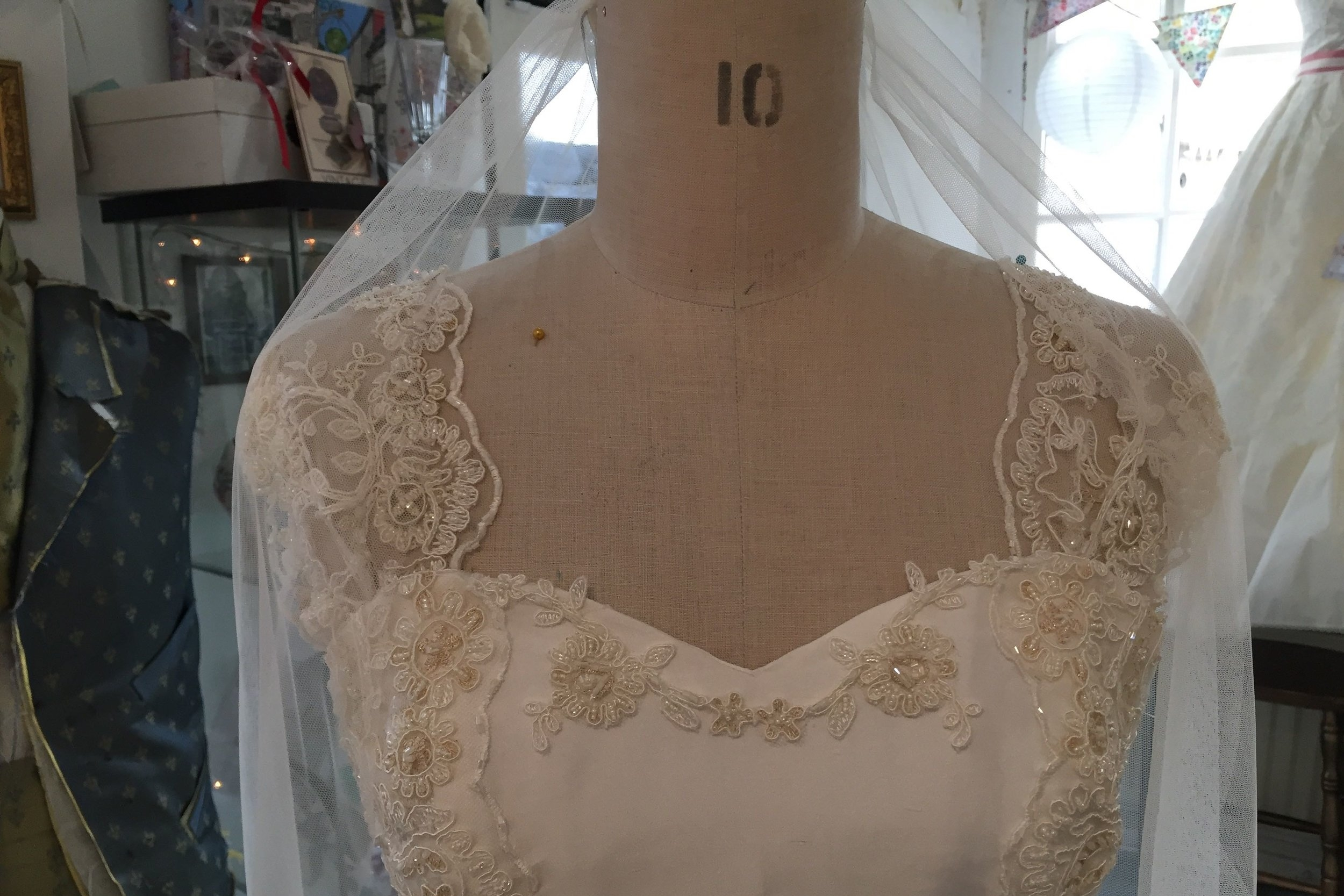 dress on stand close up.jpg
