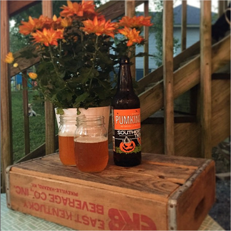An old soda crate makes a perfect base to elevate items like casseroles, flowers, and even beer!