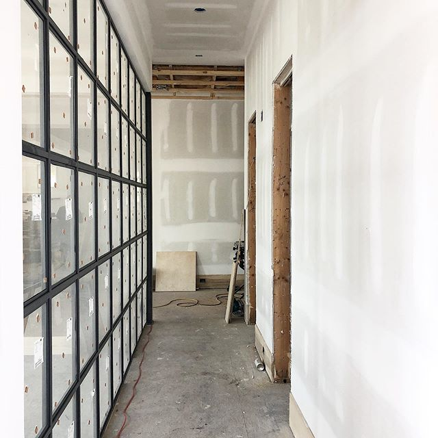 Today we finalized the furniture that will go on the other side of this steel wall, and the surface mounts above in the hall. Get ready, it's good! . . #interiordesign #charlestoninteriors #charlestoninteriordesign #charlestoninteriordesigner #interiorinspiration #moderndesign #moderninteriors #underconstruction #newbuild #interiordesigner #homeinspiration #interiorinspo  #interiormakeover #interiordecorator #interiorlovers #beccajonesinteriors #interior123 #dayinthelifeofadesigner  #charlestoninteriordesign #homedesign