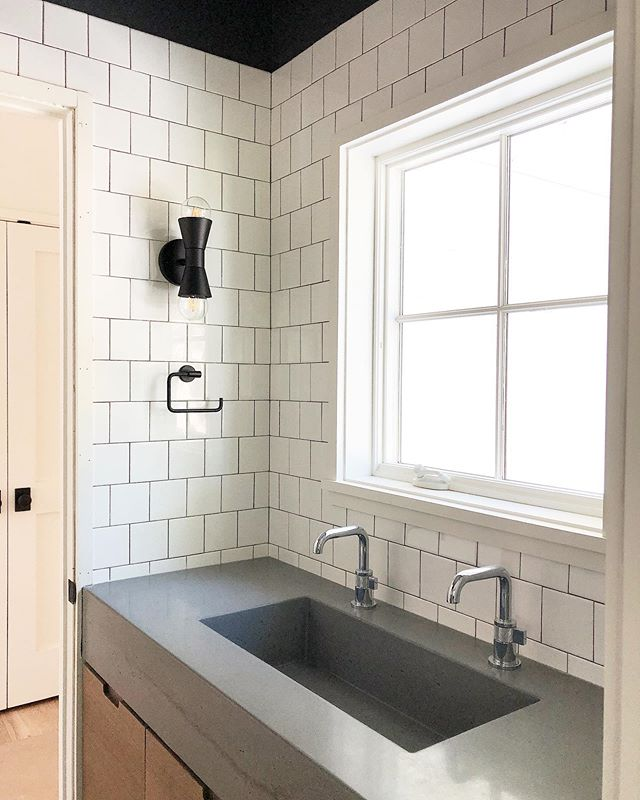 At the risk of oversharing, because I am sure I'll share again after the mirror goes up and professional photos are taken, here is one of my favorite bathrooms these days. Complete with white oak custom vanity and concrete trough sink for two! I love when what is in my head comes to life. . . #interiordesign #charlestoninteriors #charlestoninteriordesign #sodomino #cedarandmoss #concretecountertops #charlestoninteriordesigner #interiorinspiration #homeinspiration #interiordesigner #homegoals #homeinspiration #bathroomgoals  #interiorinspo  #boysbathroom #bathroominspo #bathroomdesign #interiorlovers #beccajonesinteriors #interior123 #paintitdark  #charlestoninteriordesign #homedesign #interiordesignideas