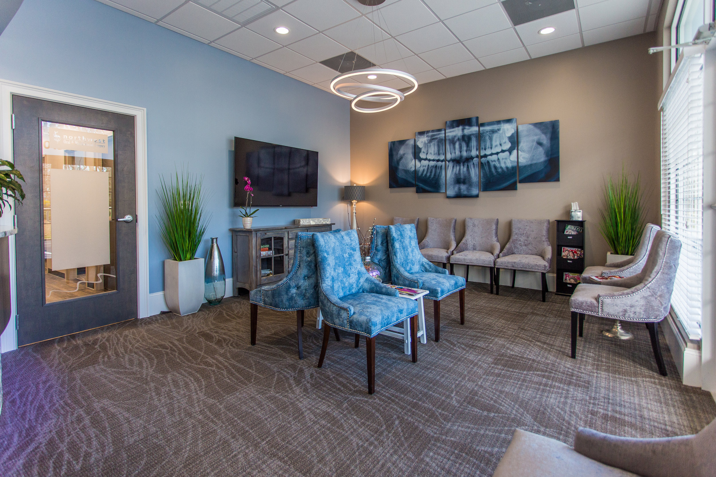 A nicely designed, clean lobby for guests to relax in while they wait.