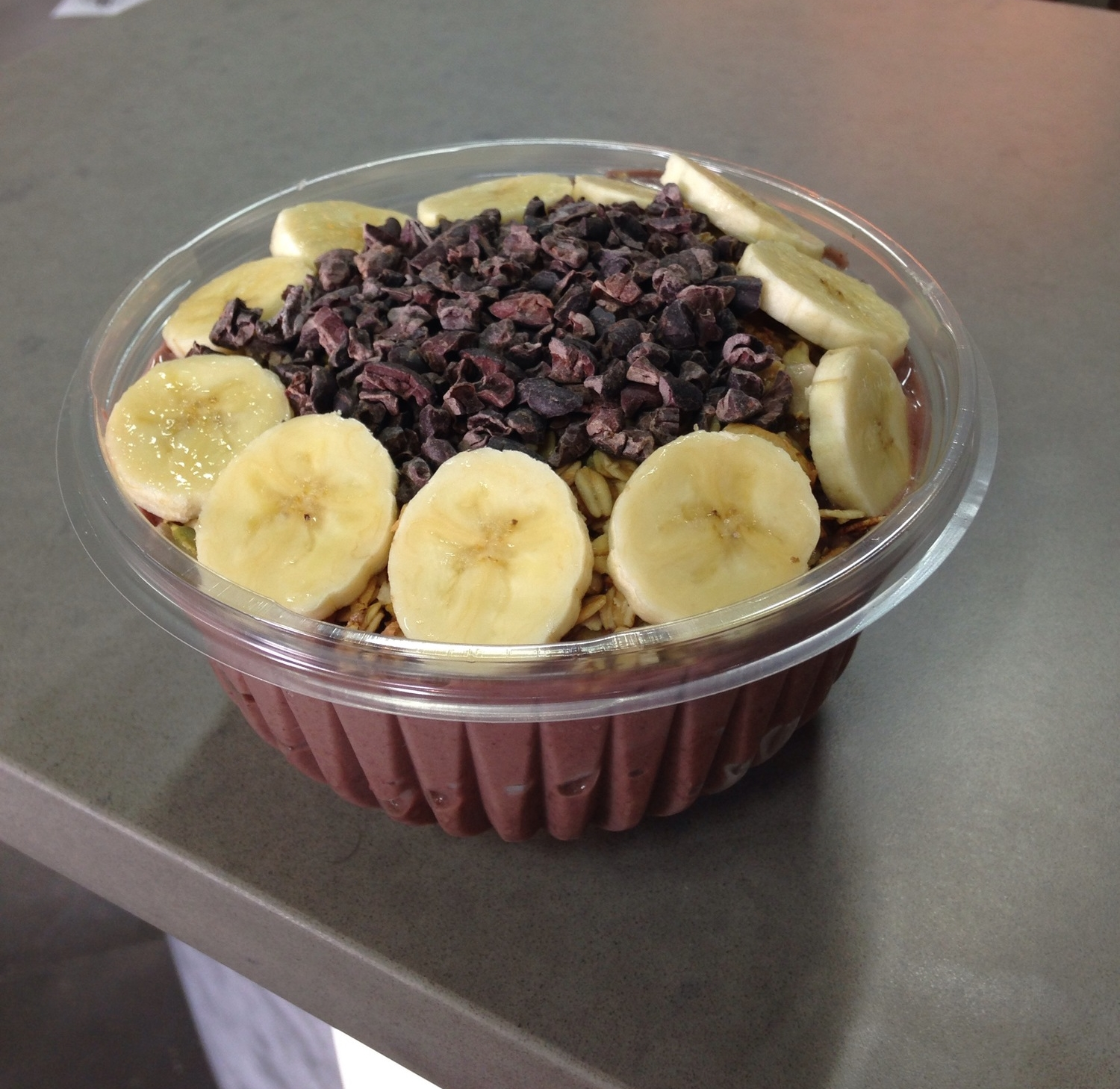 Raw Republic's PB&A Bowl: acai, banana, almond milk, and peanut butter blended together, topped with sliced banana, granola, and cacao nibs.