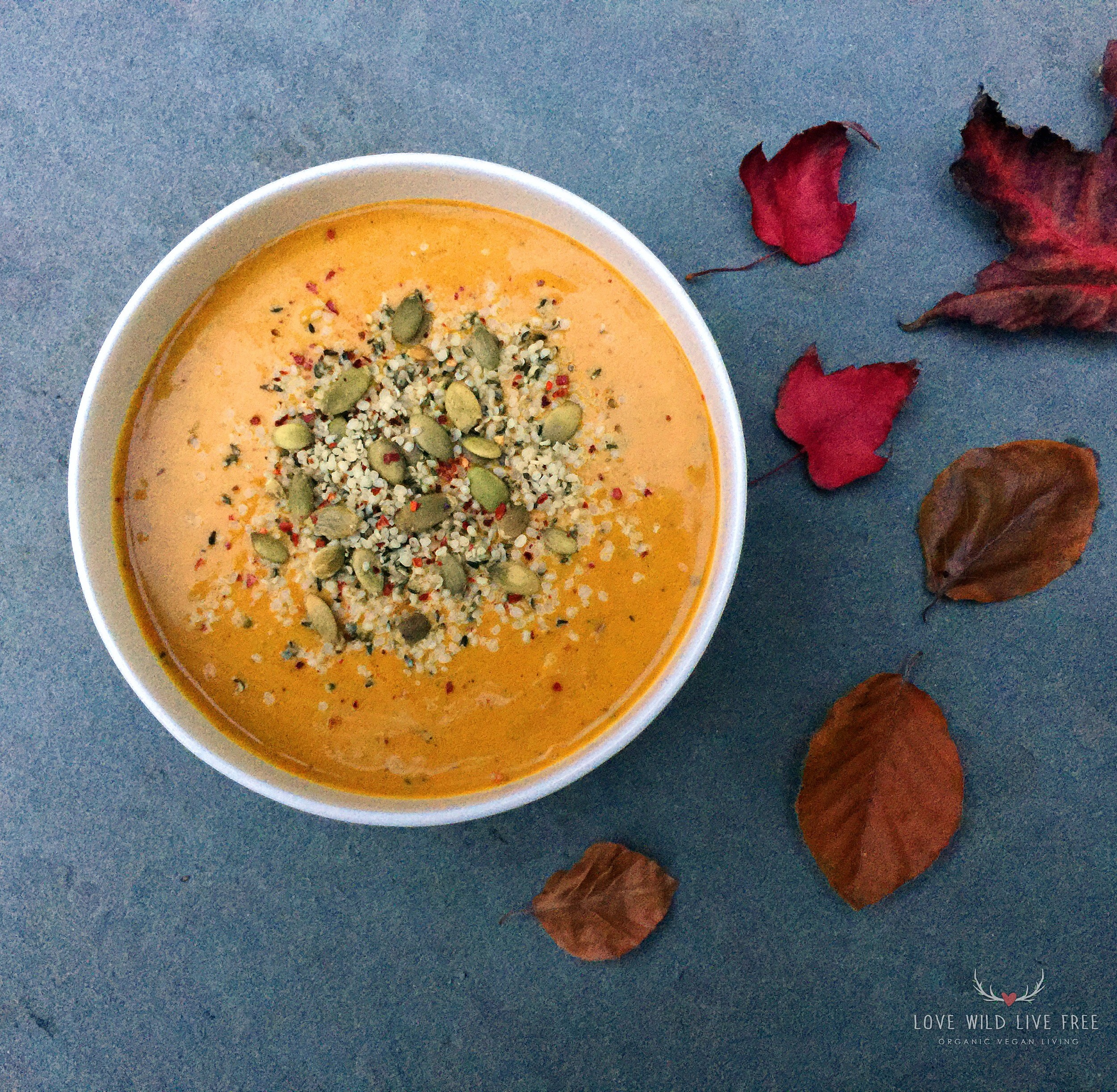Creamy vegan coconut curry butternut squash soup, topped with raw pumpkin seeds, hemp hearts and red pepper flakes! Immune boosting spices and clean, dairy-free ingredients, for a warming meal as the cool weather rolls in.