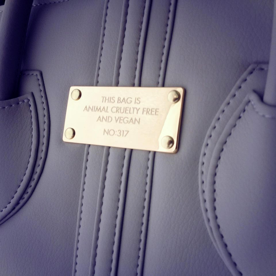 Alexandra K.   handbags, available through allTRUEist, are handmade in Poland using high quality vegan fabrics and fine Italian hardware. Each bag has a unique serial number which is   hand engraved on the front plaque.   Photo courtesy of allTRUEist.
