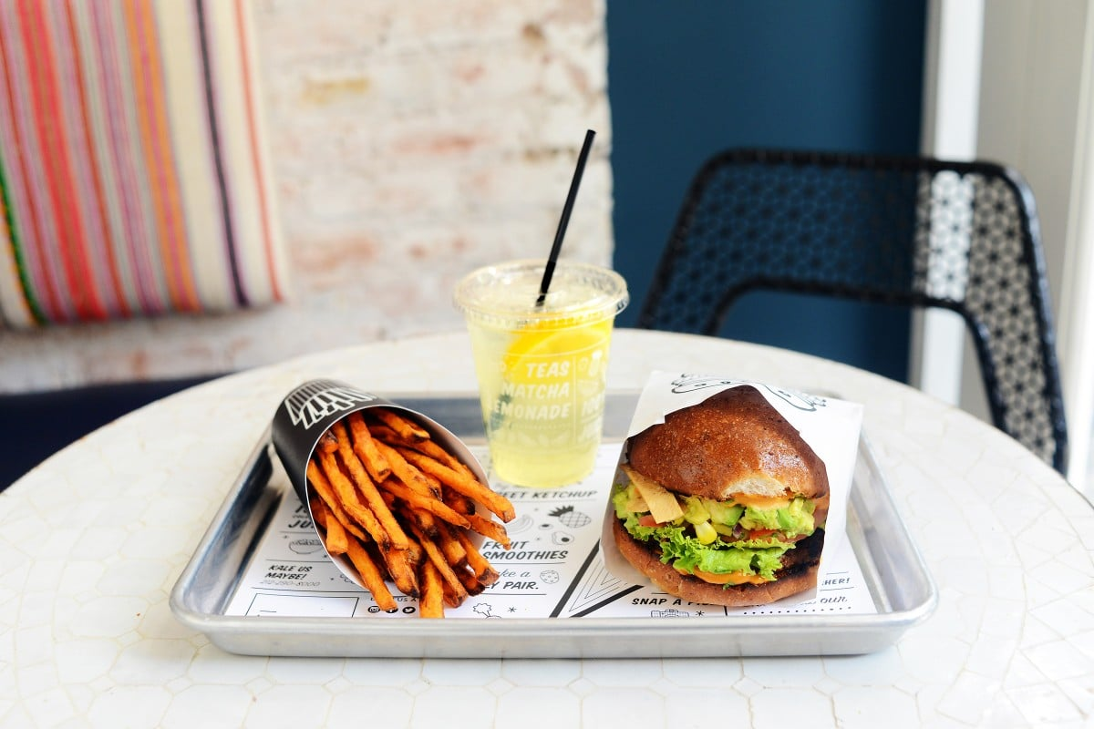 by CHLOE. Guac Burger - a black bean-quinoa-sweet potato patty, topped with sweet corn salsa, onion guacamole, chipotle aioli and tortilla strips. Also pictured: Air Baked Sweet Potato Fries and Seasonal Lemonade.  Photo source: Forbes.com.*