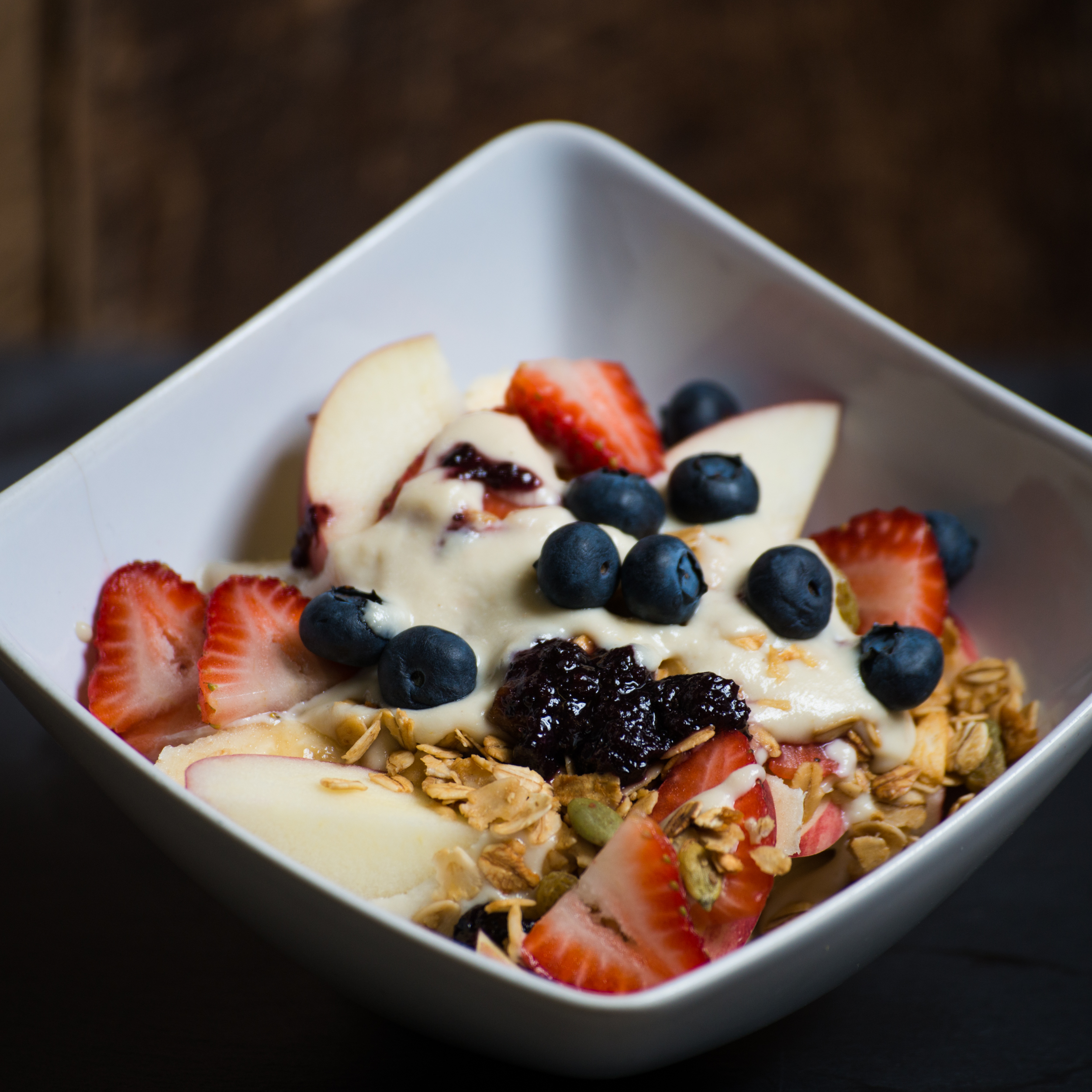 Sweet Cashew Cream Cheeze with apples, bananas, strawberries, blueberries, raw granola with pumpkin seeds.  Photo by Culcherd.