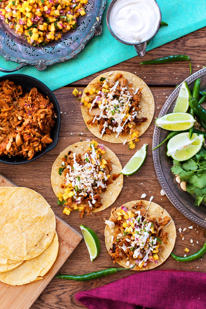 """Doesn't the sight of these Jackfruit Carnitas """"Pulled Pork"""" Tacos make you want to put on some fiesta music and cook up this amazing meat-free feast? The texture of Jackfruit is the perfect plant-based swap for pulled pork and young jackfruit,much like tofu, has no taste so it will absorb the flavour of the marinade.Photo credit: Kyla Zanardi."""
