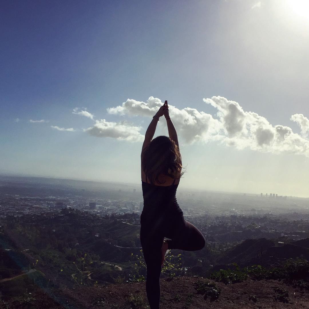 Taking Vrikshasana (tree pose) on a hike through Griffith Park, Los Angeles, to the peak of Mount Hollywood.  Photo: Love Wild Live Free.