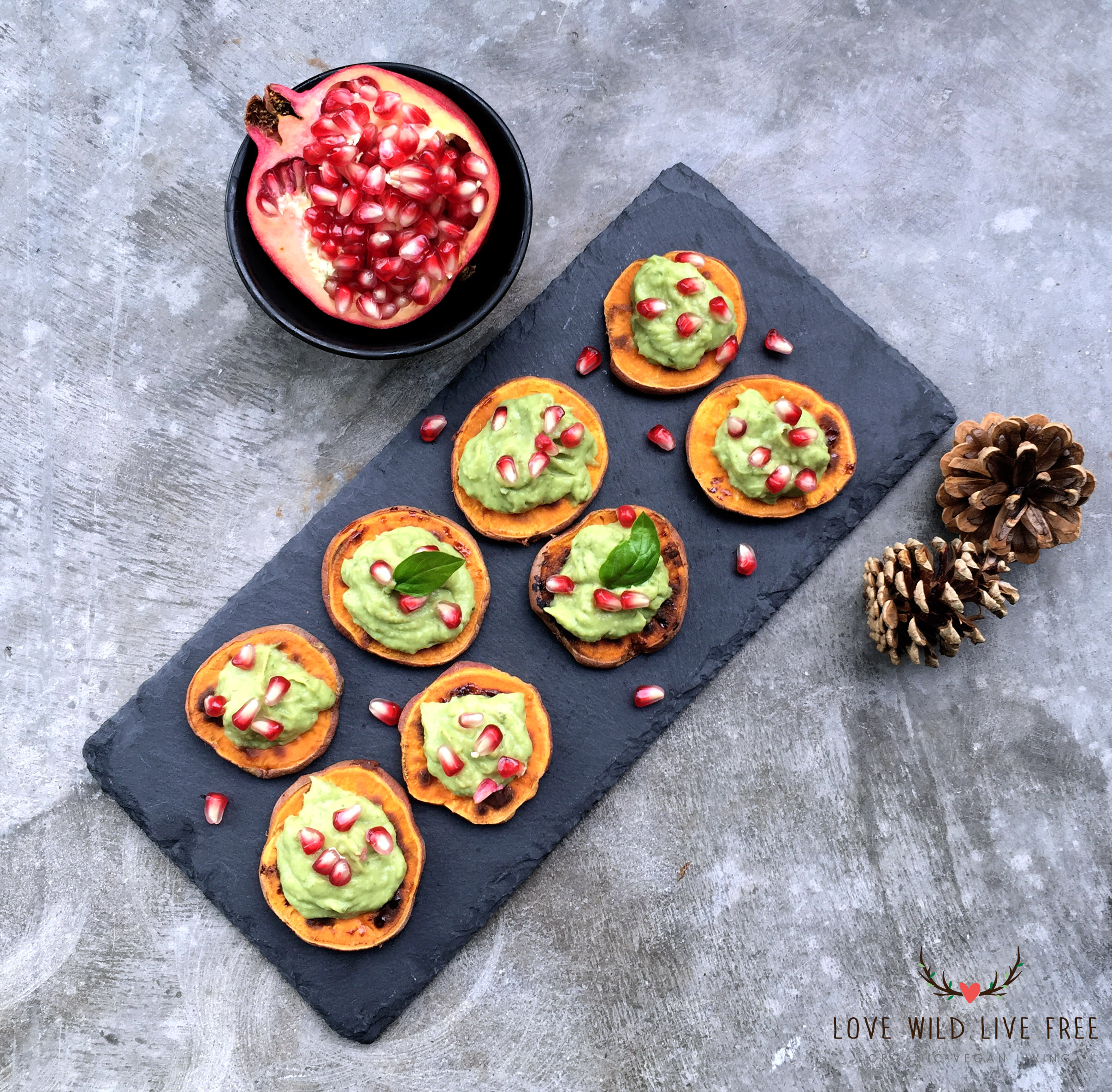 """Sweet Potato """"Crostini"""" with Avocado-Pesto and Pomegranate for the Ultimate Vegan Thanksgiving. Photo by Love Wild Live Free."""
