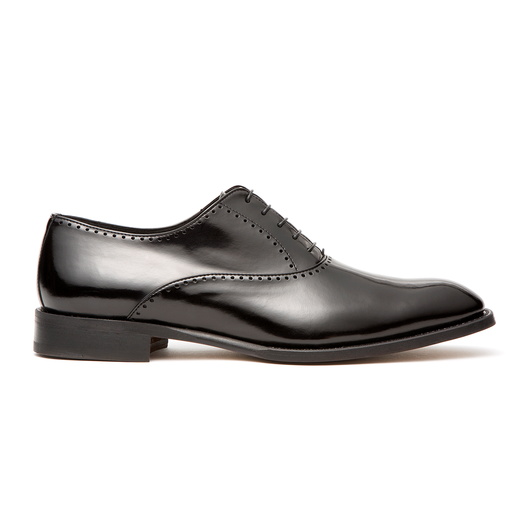 """These black Oxford men's Brogues, from Opificio V's """"Black Label"""" line,are hand-crafted to the highest specifications in the company's Italian atelier. The fine vegan leather and clean, sweeping lines create a distinctly elegant appearance which disguise the complex skill and construction required to make such luxuriously well-appointed footwear. A smooth polished finish marks a sleek Italian-leather oxford accented with meticulous broguing and traditional craftsmanship (hand stitched using the Blake method). They also come in brown, which you can check out  here ."""