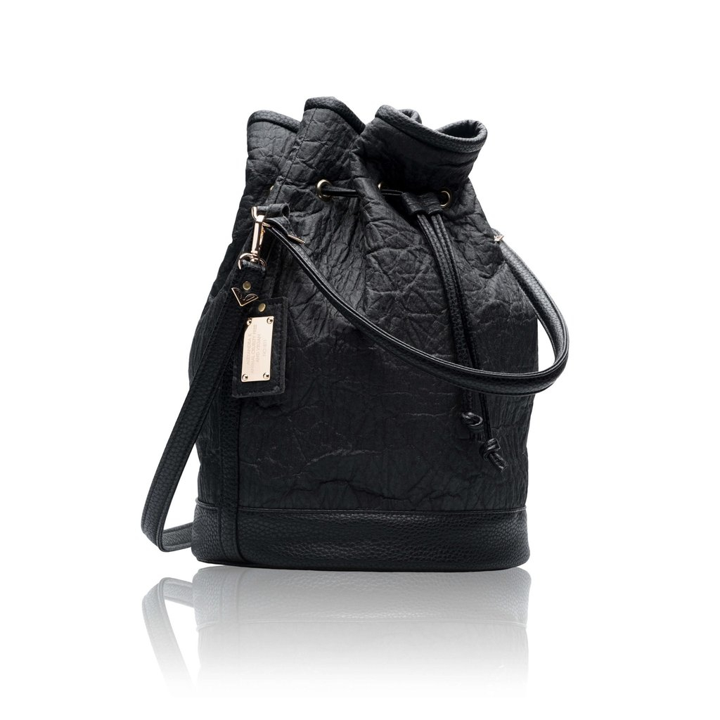 """This beautiful bucket bag from Alexandra K. made from pineapple """"leather"""" is at the top of my wish list this holiday season! Piñatex™ is an innovative, natural and sustainable non-woven,high performance textile made from pineapple leaf fibers. The fibres are the by-product of the pineapple harvest and no extra land, water, fertilizers or pesticides are required to produce them. What's more is Piñatex provides new additional income for farmers, while creating a vibrant new industry for pineapple growing countries."""