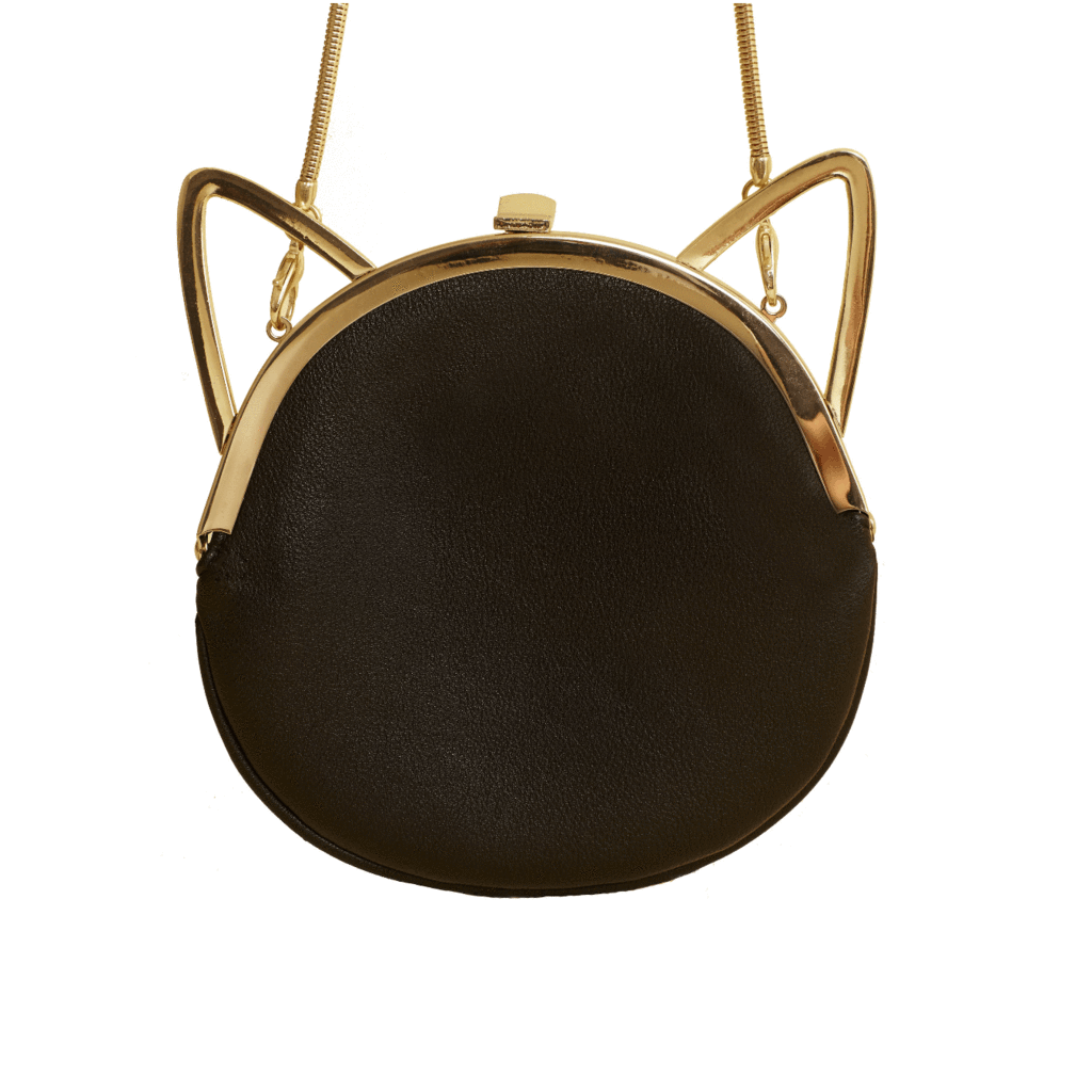 This Kiki is Maaaaarvelous! Kiki: A party including good music and good friends, held for the express purpose of calming nerves, reducing anxiety and stress. May involve locked doors, tea and salacious gossip. This cat ear crossbody handbag/clutch will be your go-to bag and take you into a fun evening with a removable coil chain turning into a fab clutch.