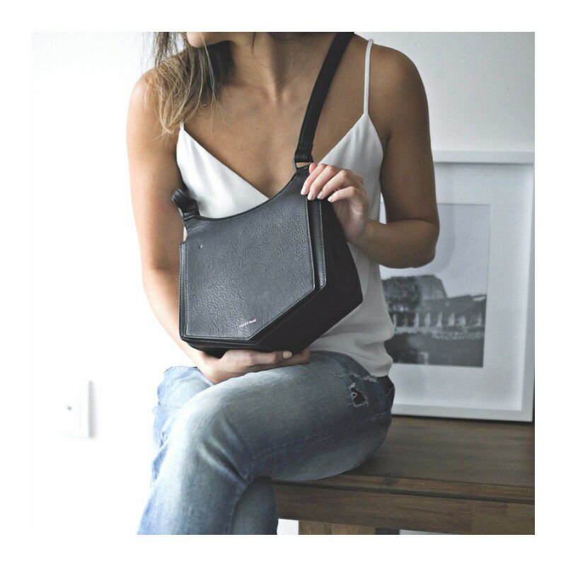 The Pailey Crossbody in Black by Pixie Mood is a stylish cross body bag,made with vegan leather.  Photograph by Pixie Mood.