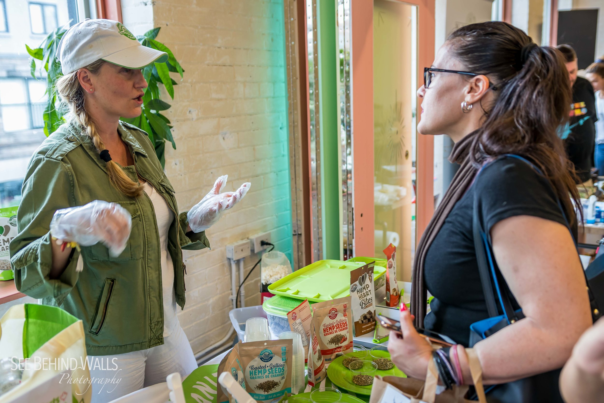 Manitoba Harvest Hemp Foods  served up their Toasted Hemp Seeds, Hemp Bites and freshly popped popcorn topped with their Hemp Oil and a selection of Hemp Toppers! Photo by Alex Bez, See Behind Walls  Photography .