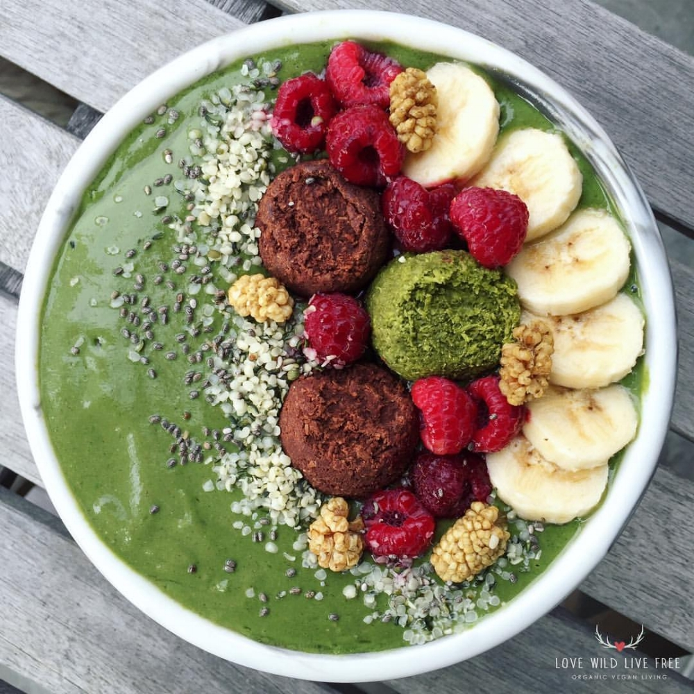 Smoothie bowls are an easy to make meal that you can enjoy any time of the day! I made this green beauty with spirulina powder, Manitoba Harvest Hemp Foods hemp heats, chia seeds, fresh baby spinach and spring water, then topped it with Koukla Delights Mini Cacao + Matcha Tea Macaroons, fruit and more hemp hearts.