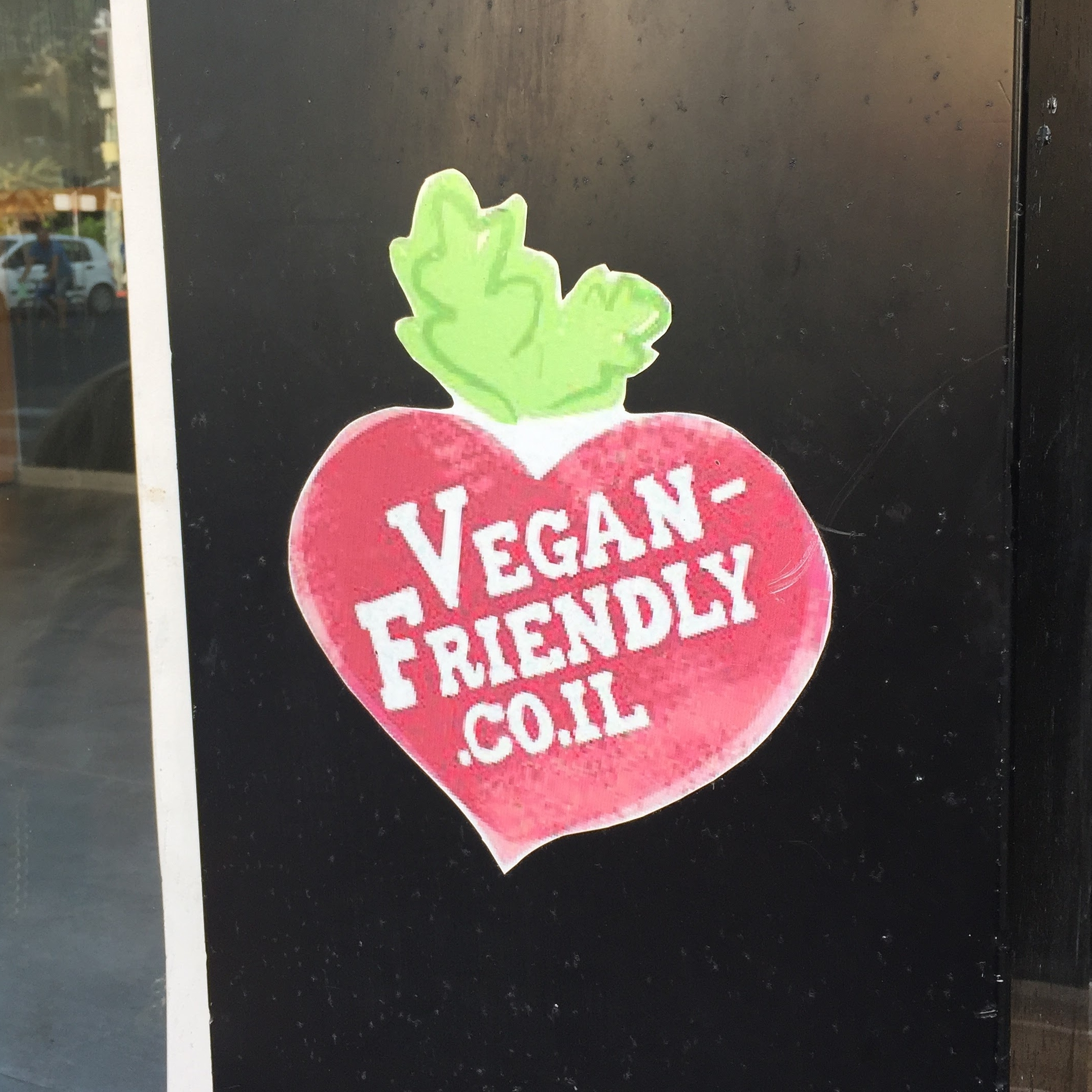 """Look for the """" Vegan-Friendly """" label at businesses and on products that are certified as vegan by the Vegan Friendly Project in Israel. Photo by: Love Wild Live Free."""