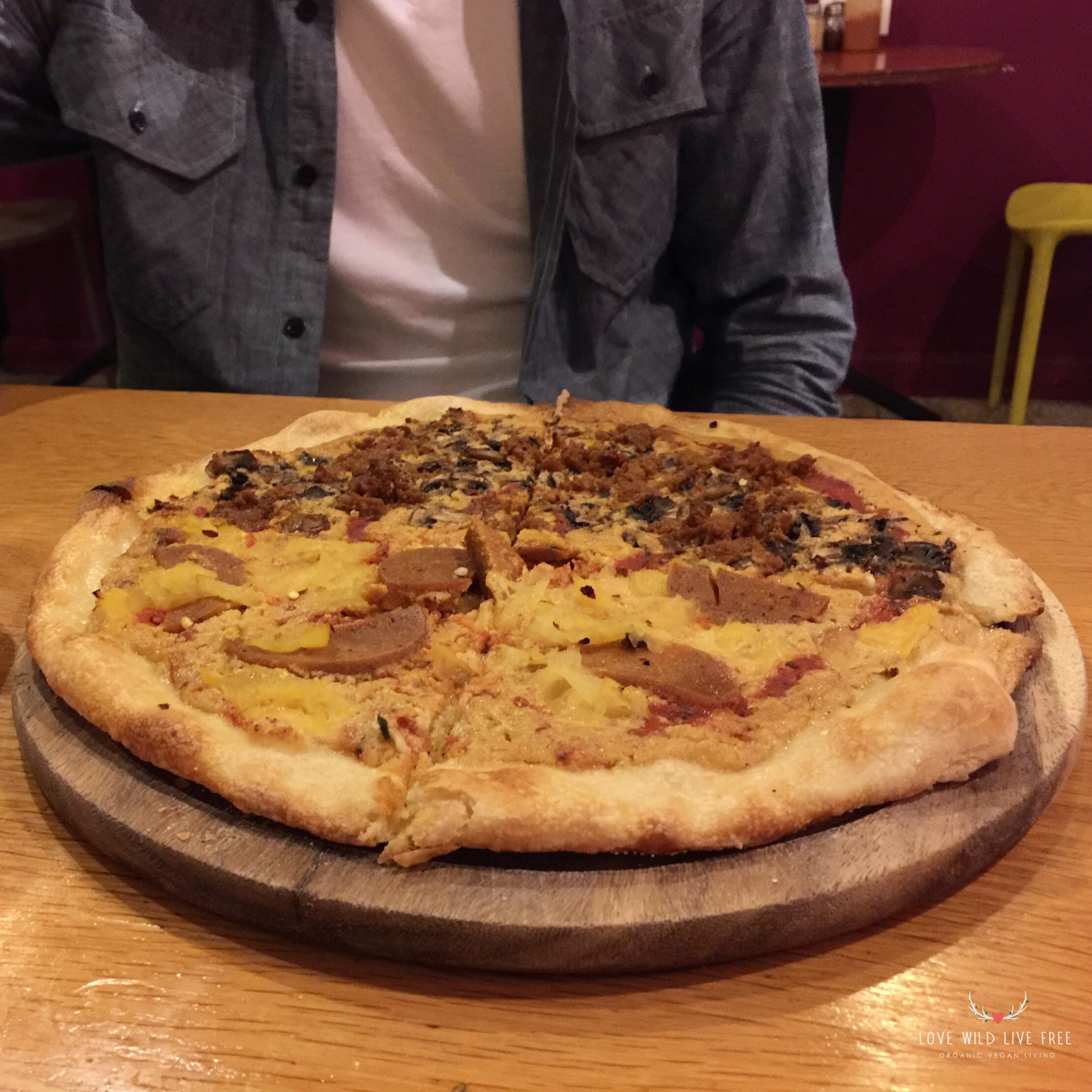 We ordered a personal pizza with house-made mozzarella cheese, and topped one half with pineapple and handmade pepperoni, and the other half with crumbled seitan and mushrooms.