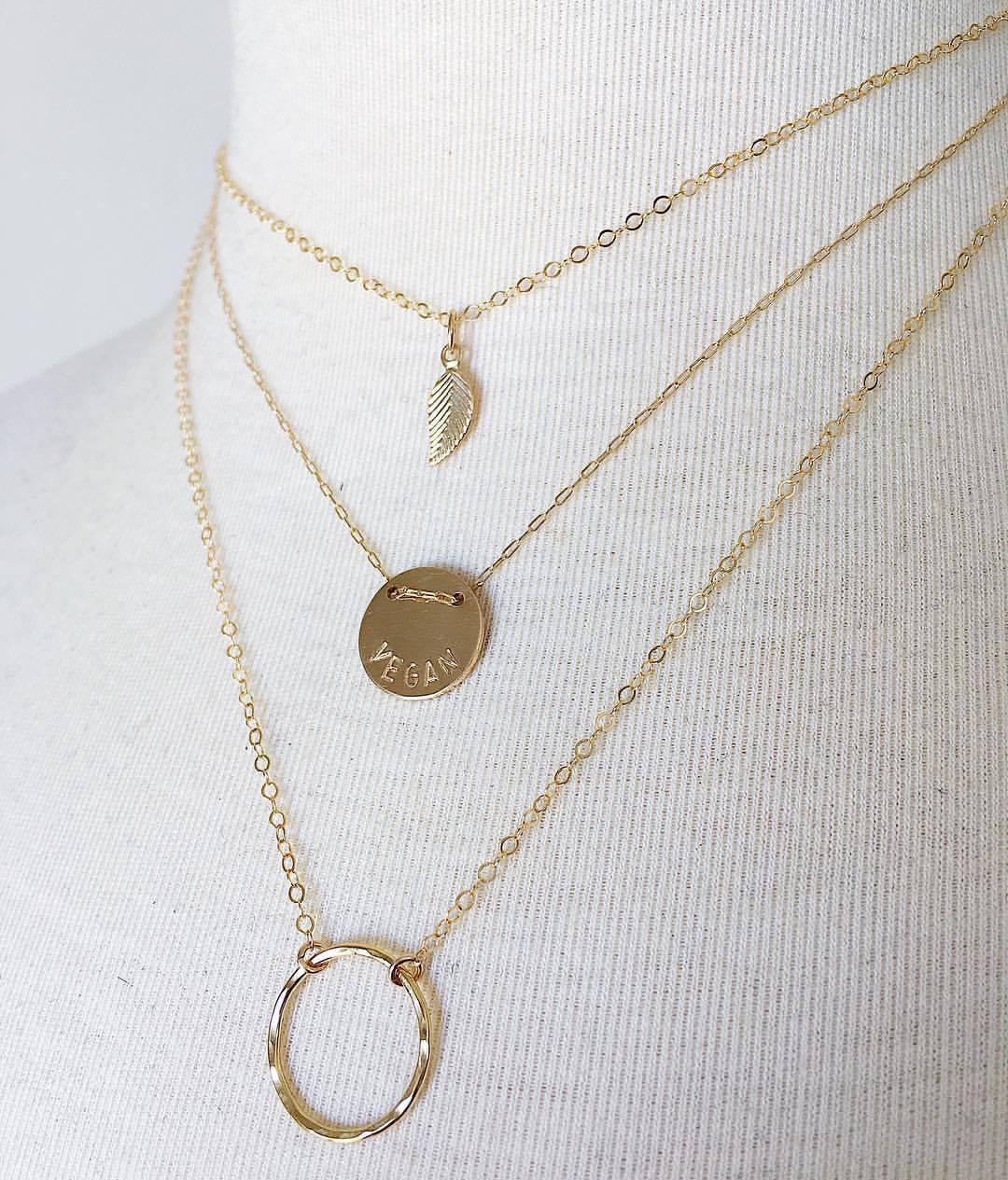 Compassion Layers in gold featuring the Earth Saver necklace with gold fill components + the 'VEGAN' Button Necklace in Gold + Gold Drop Circle Necklace by  Jewels by SJB .