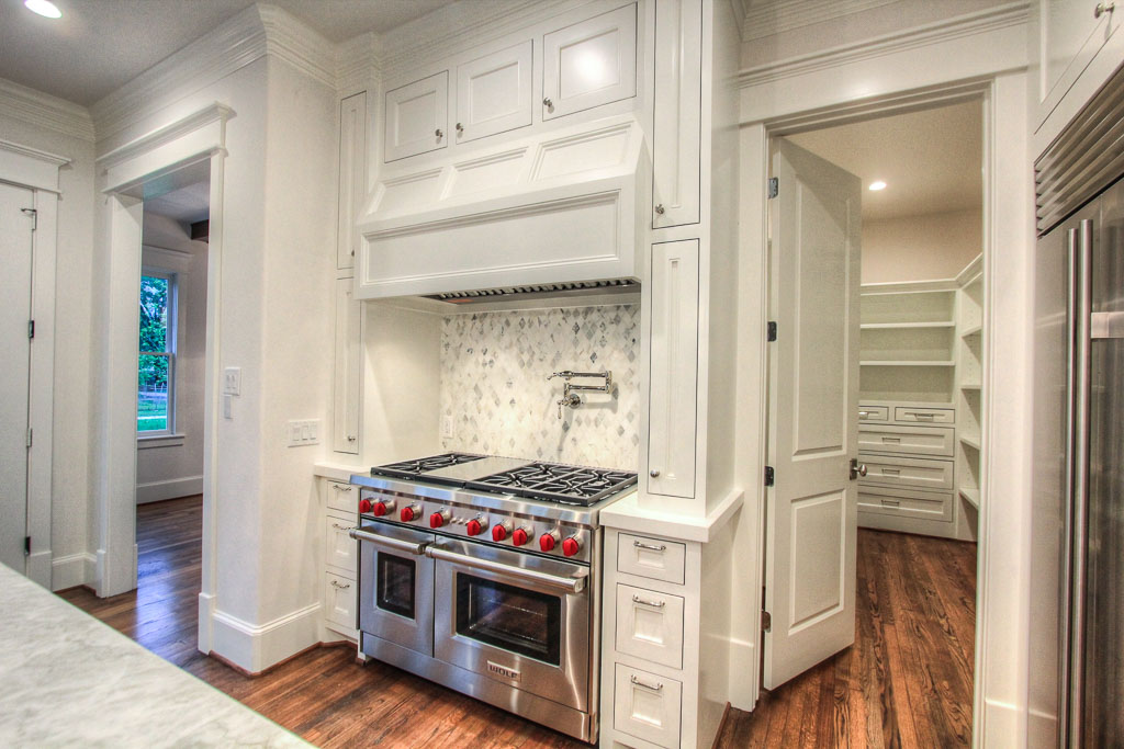 "Wolf Performance appliances, including a 48"" Sub Zero refrigerator. The marble tile in the backsplash has cool understated tones that will have a lasting appeal."