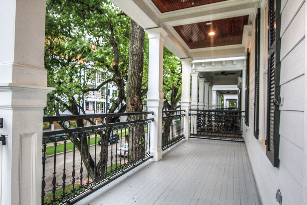 The beautiful wraparound porches on both first and second floors have an wide open view of the Heights Hike & Bike Trail and ample lighting and ceiling fans.