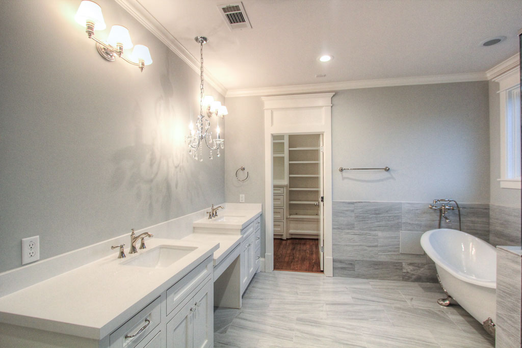 The huge master bathroom has marble floors and surrounds, with highly customized marble tile selections in the shower.