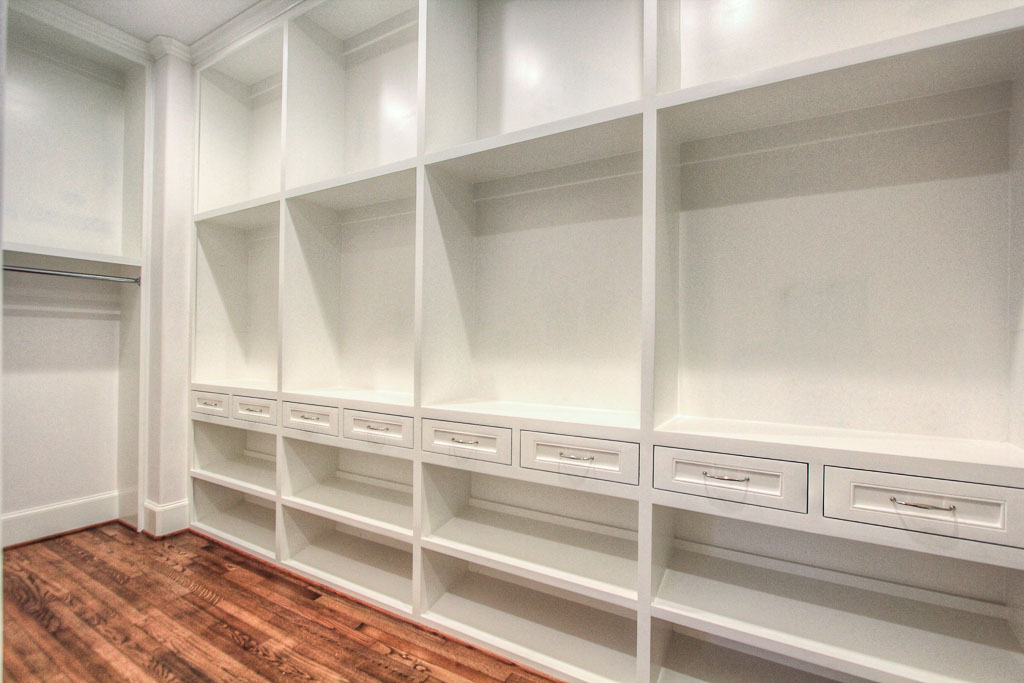 This is just one side of the master walk-in, which has 11' ceilings and rows of built-in shelving. This is a level of intricacy that is normally the result of custom design, but the builder implements thoughtful designs as a standard.