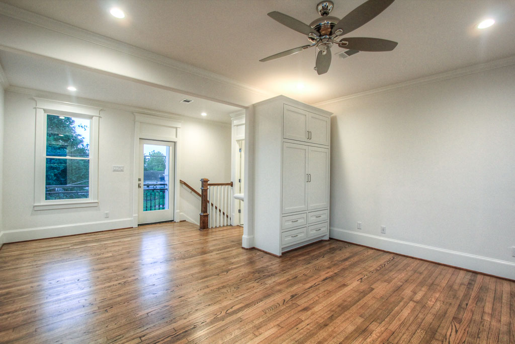 The bonus quarters have a built-in armoire that only serves to maximize the versatility of the room, and there is also a private balcony overlooking the Heights Hike & Bike Trail.