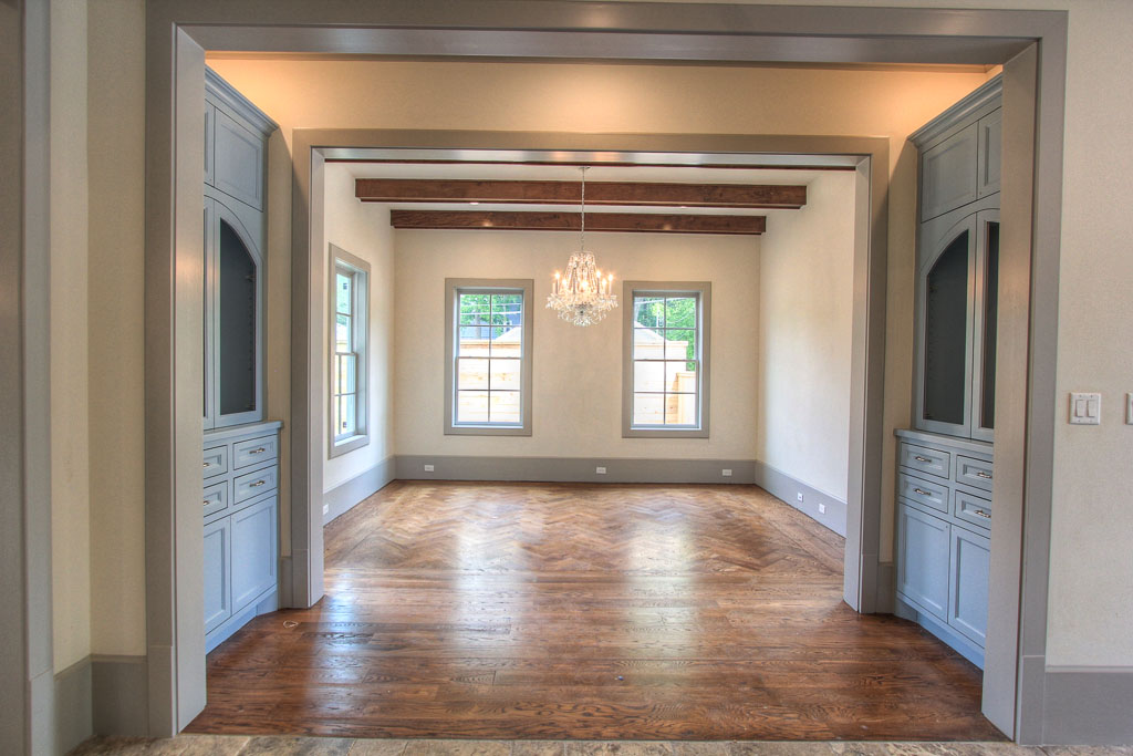"Large dining room framed by custom built-in china cabinets has a beautiful cherrywood inlay in a herringbone pattern, accenting the 5"" white oak hardwood floors that alternate throughout the downstairs."