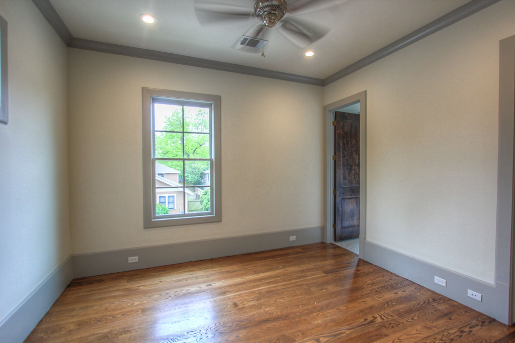 "Wide-plank (5"" white oak) hardwood floors and 12"" baseboards that flow through every room, including this secondary bedroom, create an air of curated elegance throughout. This is normally a level of detail and finishing found only in custom homes."
