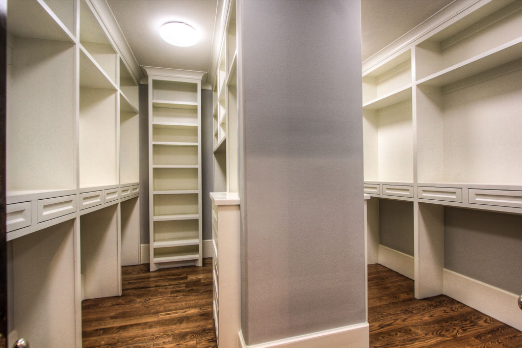 Uncommon amount of built-in storage with a separate linen area that leads to master his and hers walk-in closet.