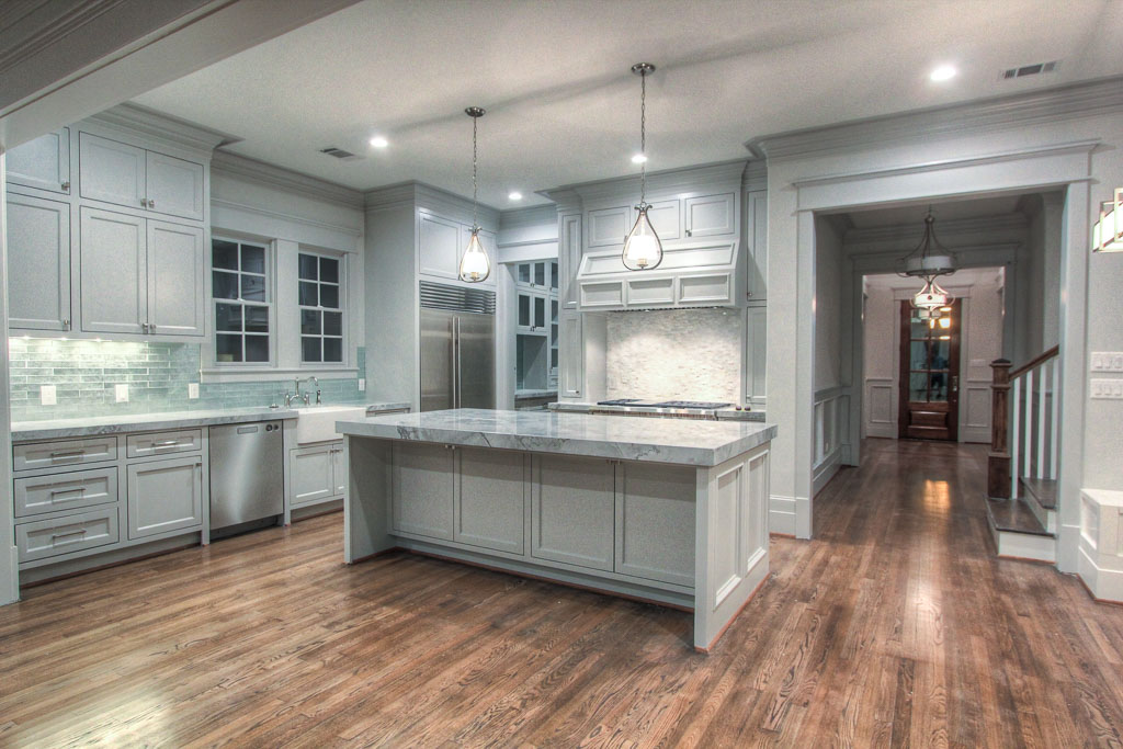 Site-built cabinetry and professional-grade Wolf Performance appliances maximize functionality of the kitchen, but the quartzite counters and Walker Zanger tile give it a distinct sense of style.
