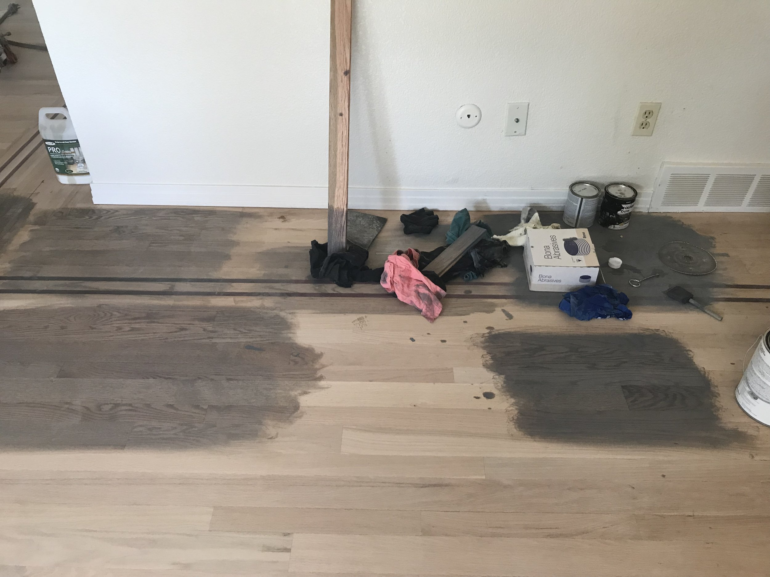 """I worked with Del, the owner of Eagle Hardwood, to mix a custom stain color. I have no idea how we even got to the final color! I think he mixed six renditions of the stain and actually ended up mixing in whitewash, so  technically it's a """"gray wash"""", according to Del."""