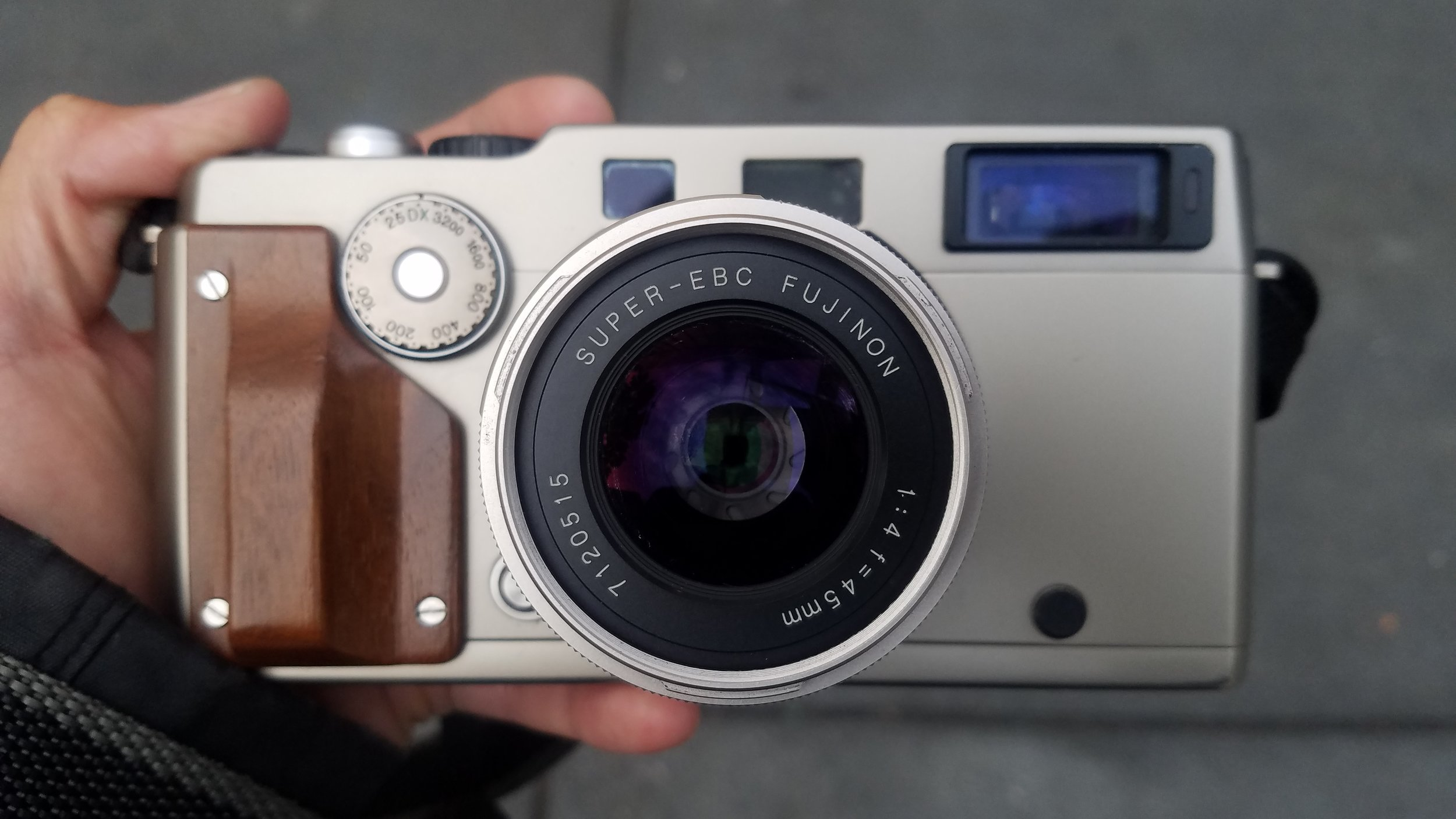Fujifilm TX-1 (Hasselblad Xpan) in silver with optional wood grip and standard 45mm f/4 lens