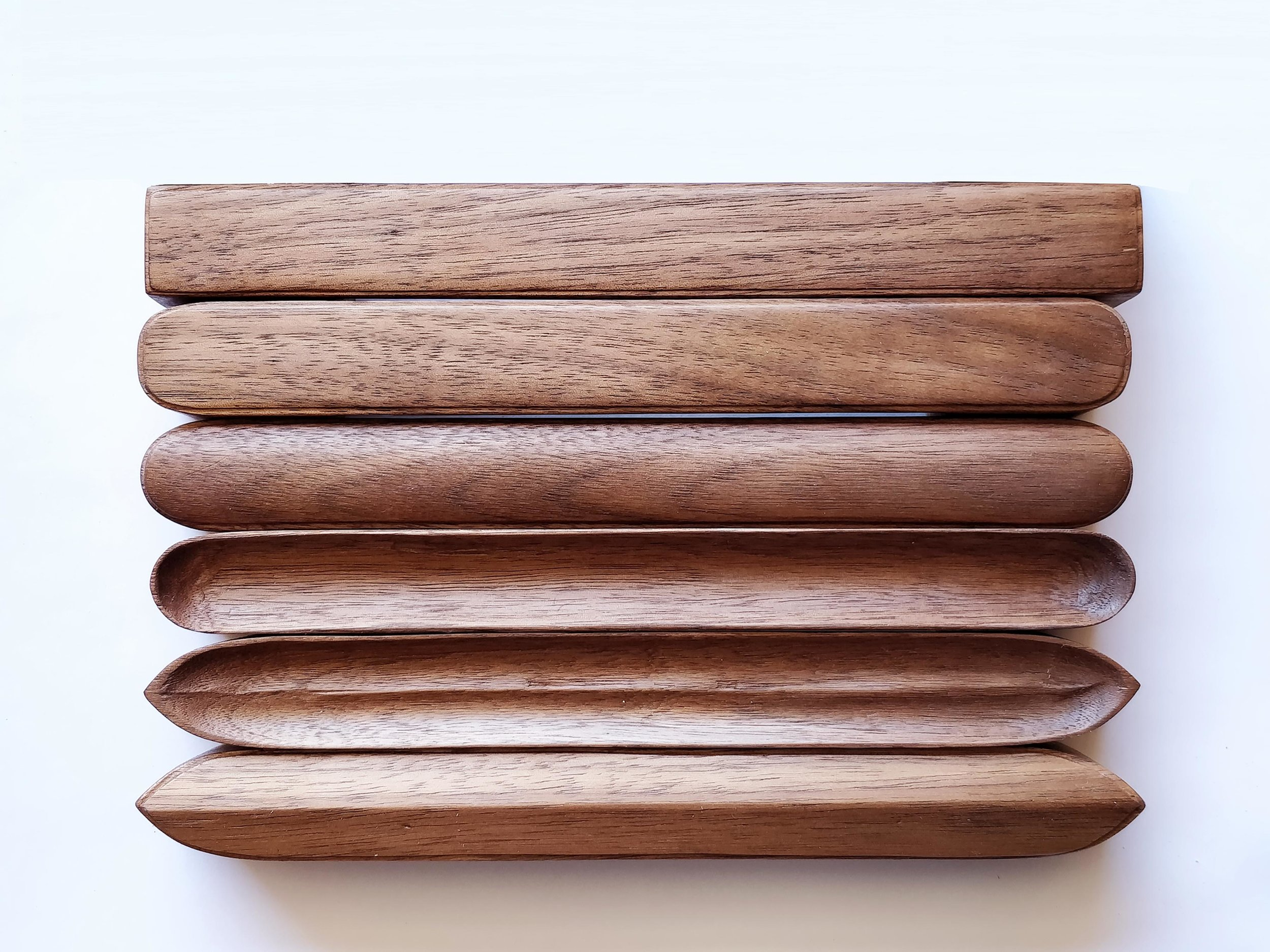 """Hand-carved drawer pulls in walnut, 1""""x8"""". From Top to Bottom:  Block, Pebble, Mound, Dish, Husk, Hull."""