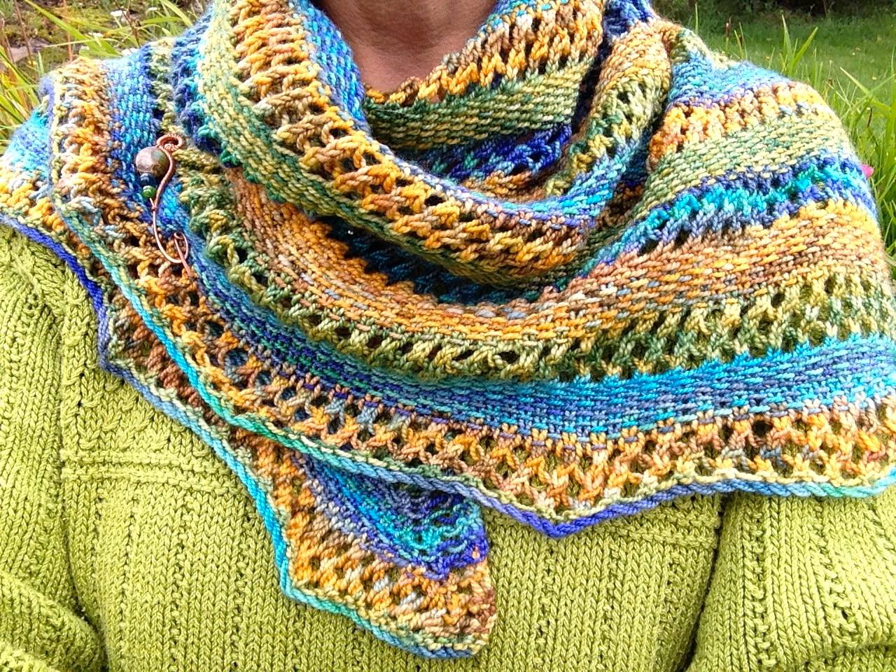 Linen & Lace Shawl   by India Tresselt,   free pattern .  Shawl pin   by   Everyday Peacocks .