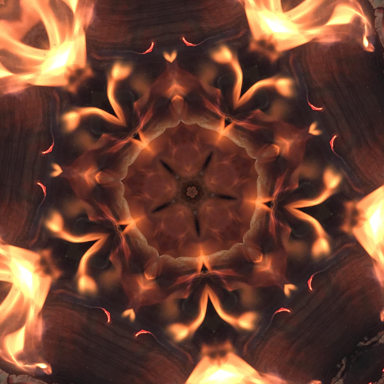 Fire in the woodstove, kaleidoscoped.